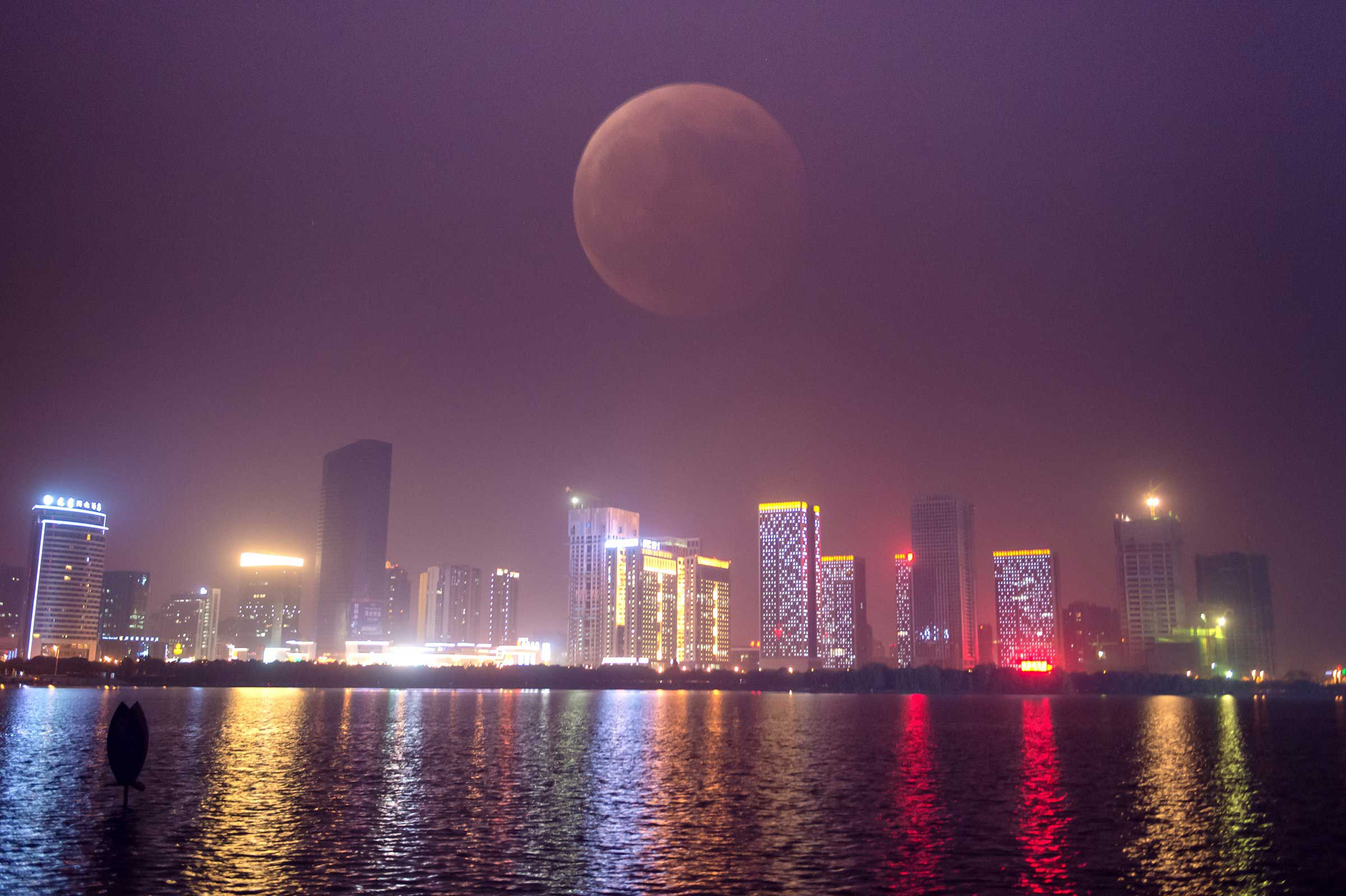 Through multiple exposures, the blood moon is shown in Hefei, China on Oct. 8, 2014.