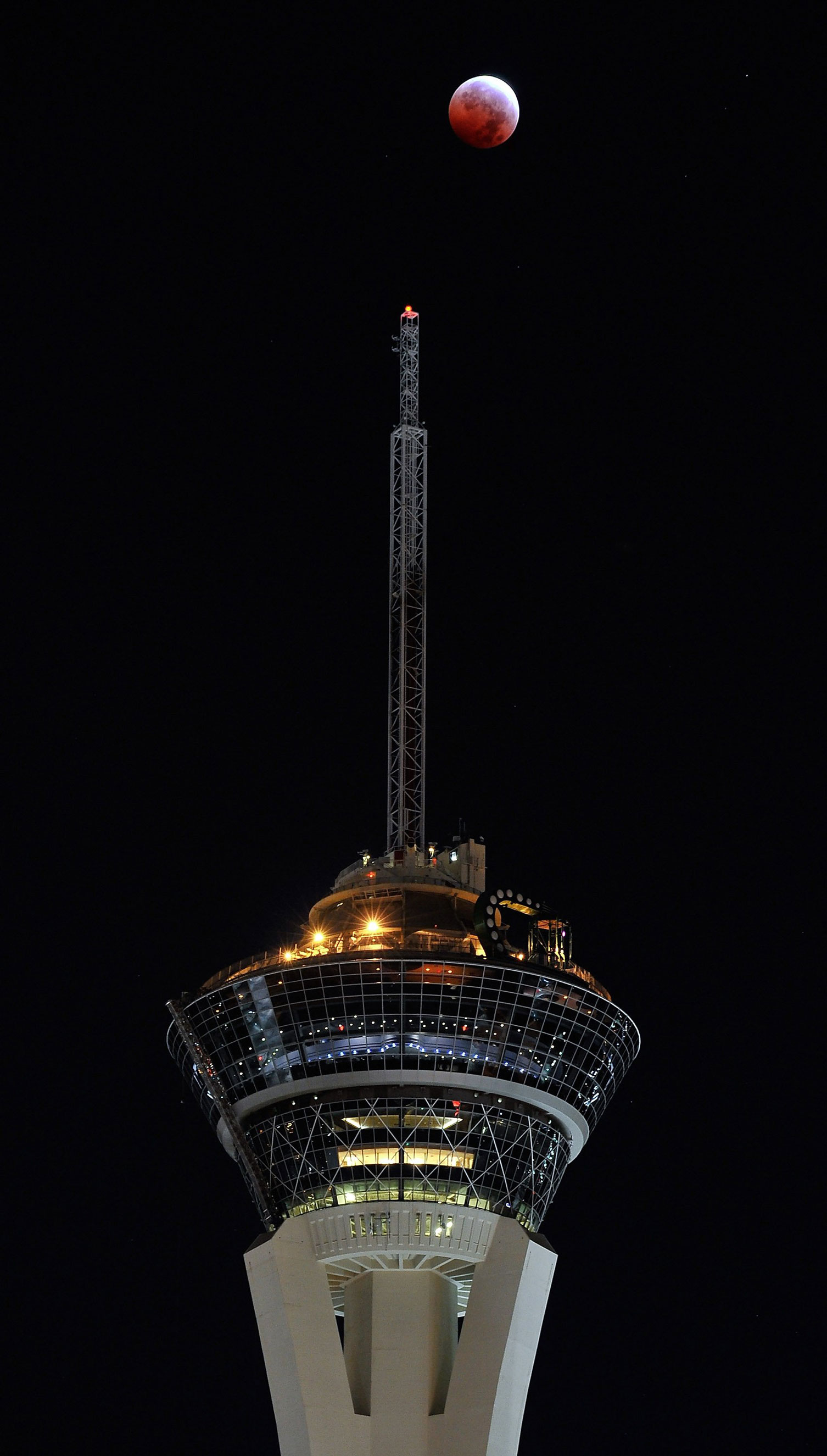 The moon during a total lunar eclipse above the Stratosphere Tower in Las Vegas on Oct. 8, 2014.