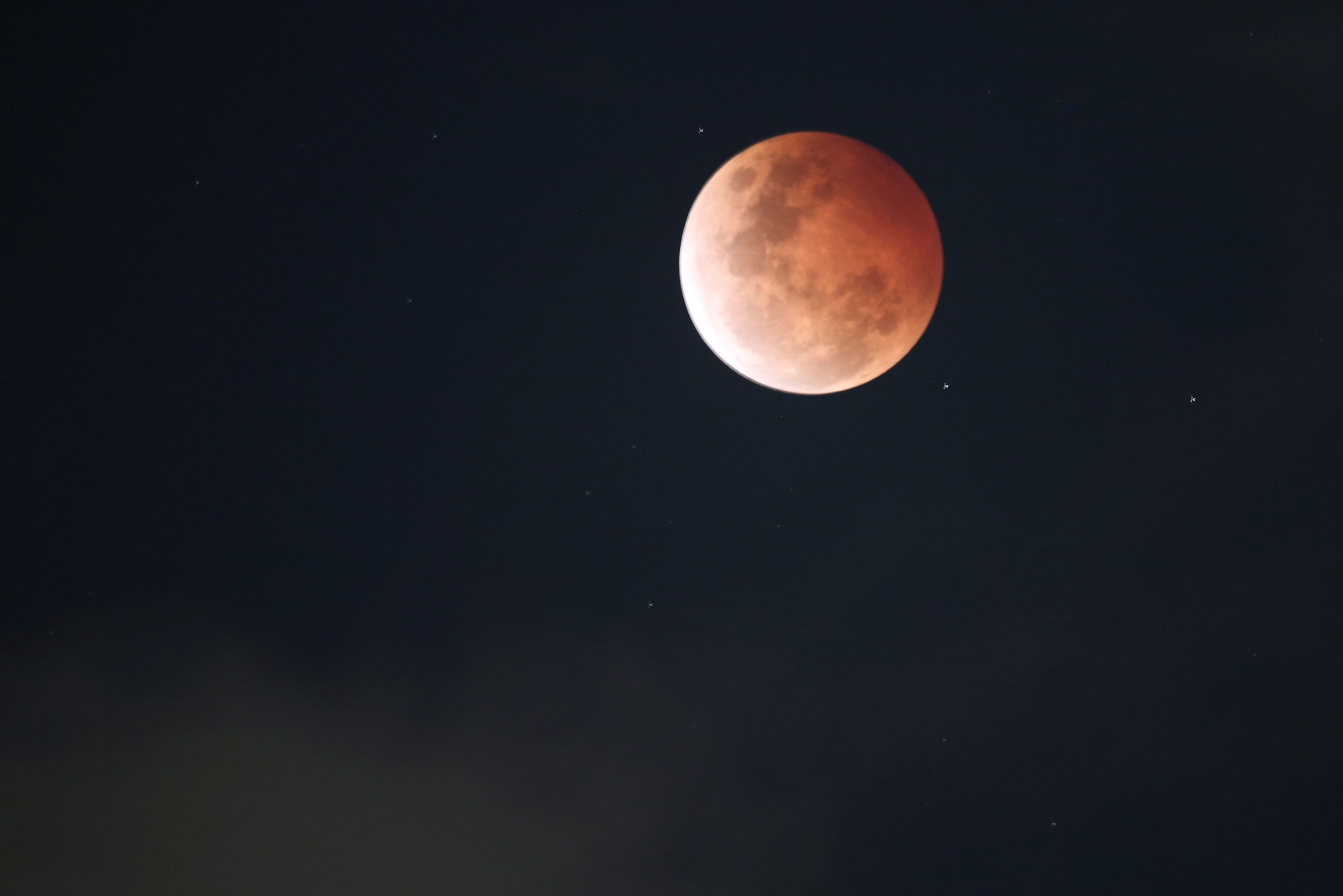 The moon during a total lunar eclipse over Sydney, on Oct. 8, 2014.