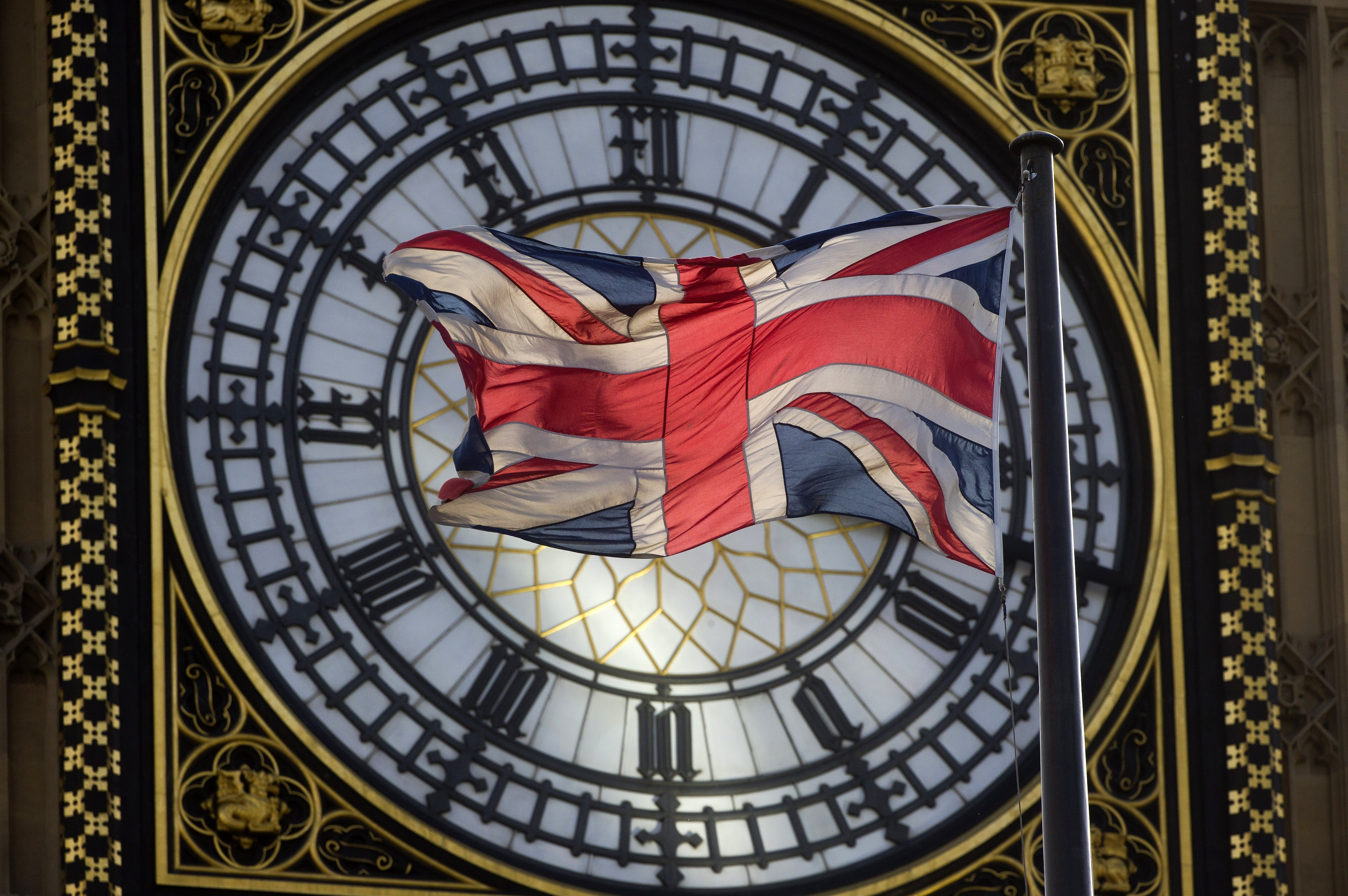 The Union flag is seen flapping in the wind in front of one of the faces of the Great Clock atop the landmark Elizabeth Tower that houses Big Ben at the Houses of Parliament.