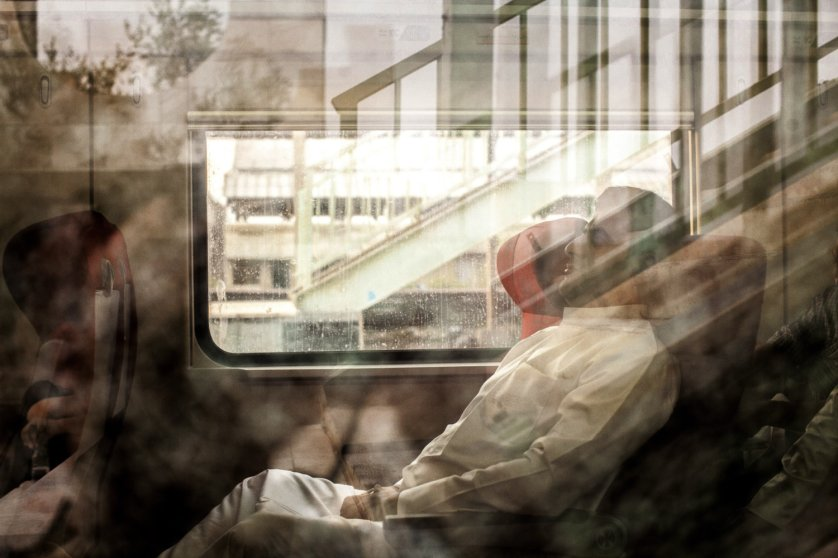 A girl looks out from a sleeping compartment on a new train preparing to leave from Basra to Baghdad, the only passenger rail service currently operational in Iraq.