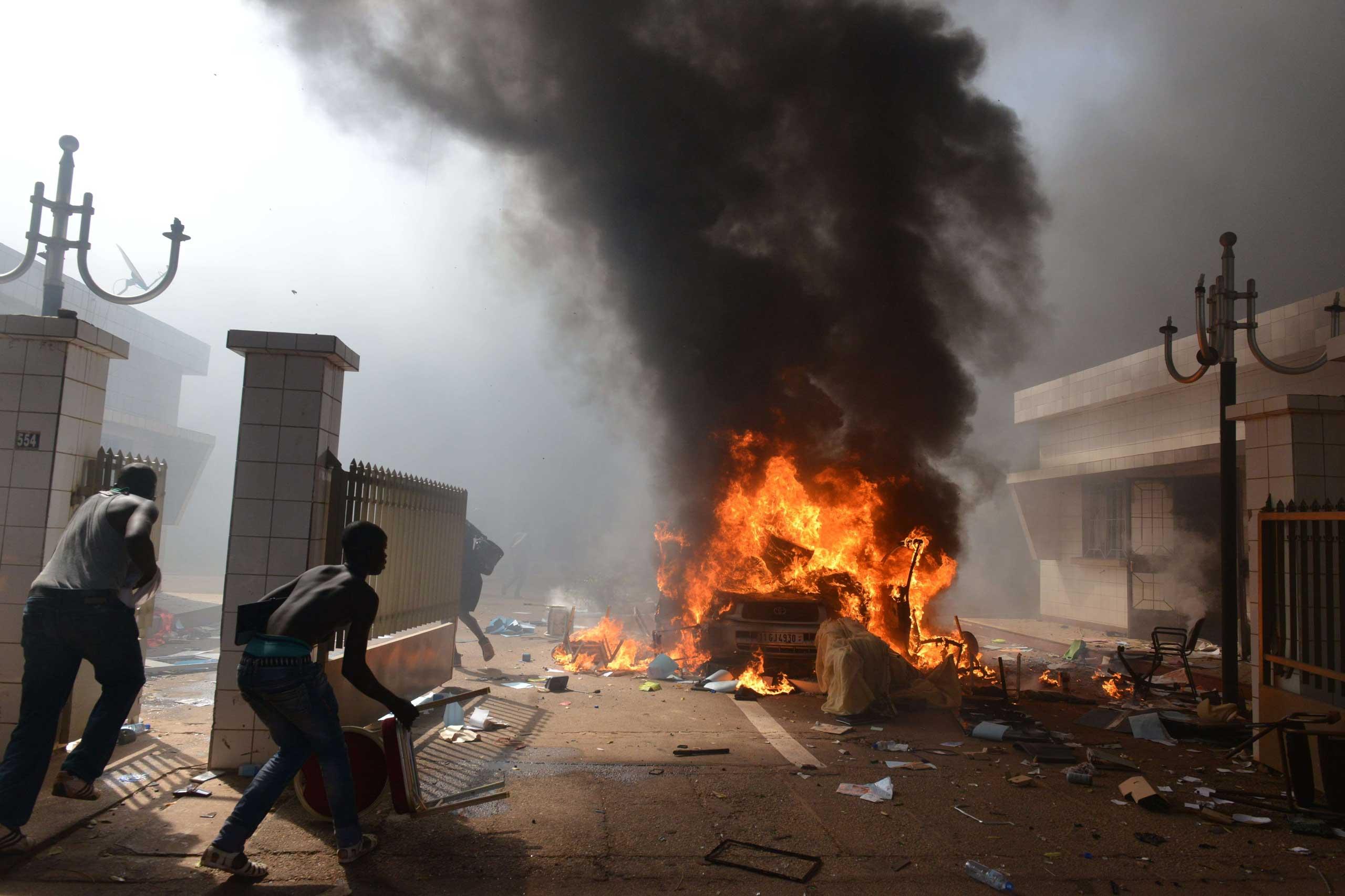Prostestors enter the parliament in Ouagadougou on Oct. 30, 2014.