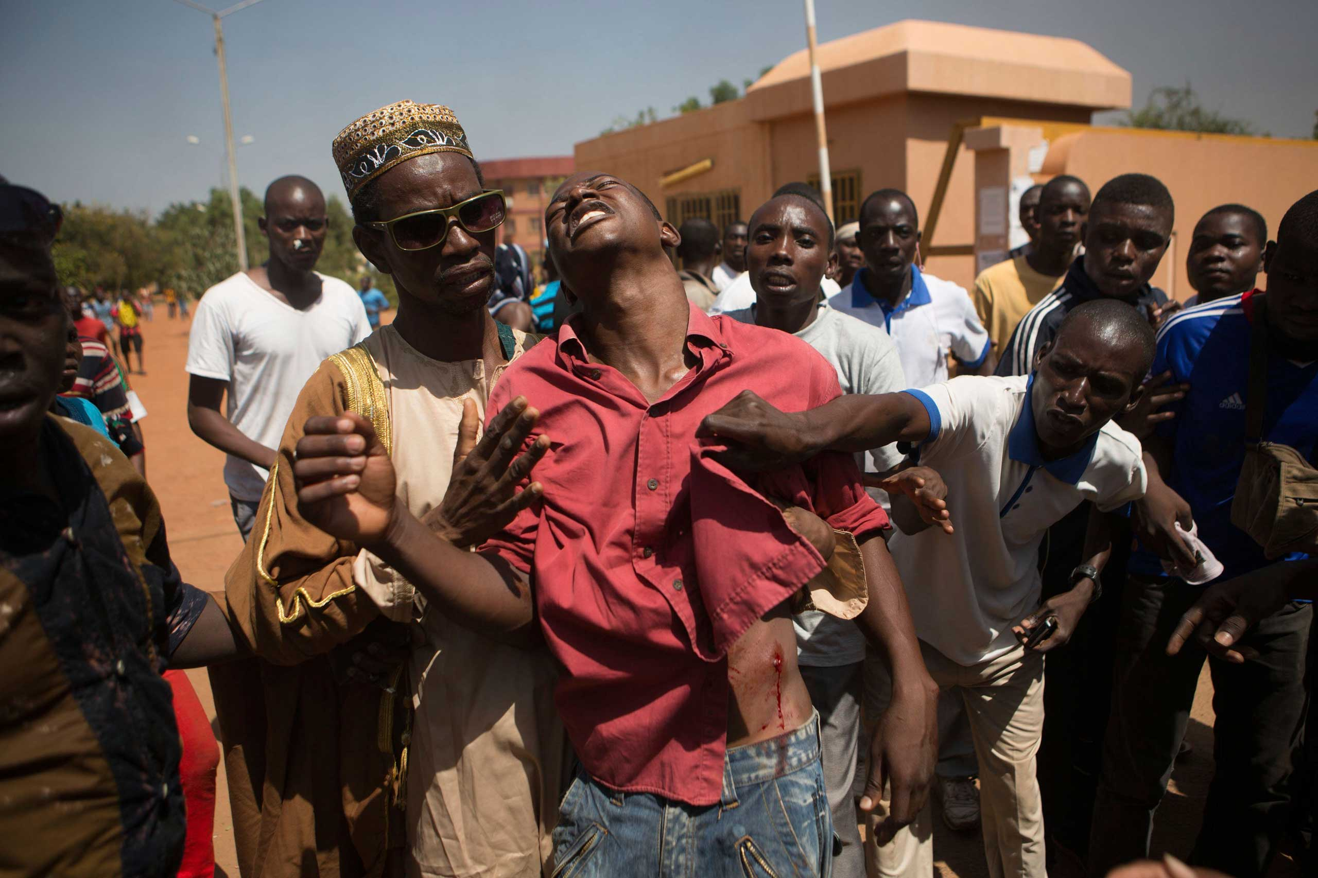 An anti-government protester is shot in Ouagadougou, capital of Burkina Faso, Oct. 30, 2014.