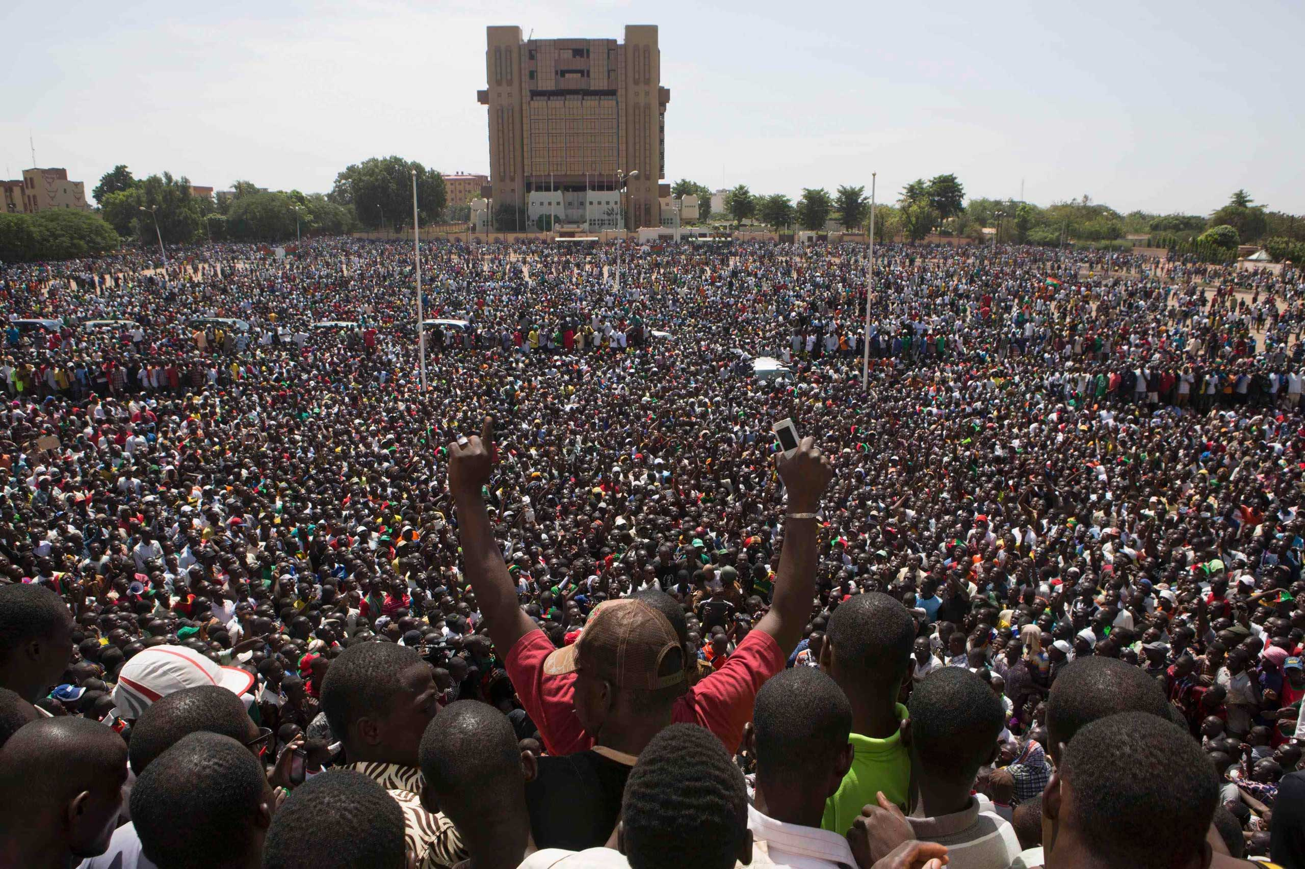 Anti-government protesters gather in the Place de la Nation in Ouagadougou, capital of Burkina Faso, Oct. 31, 2014.
