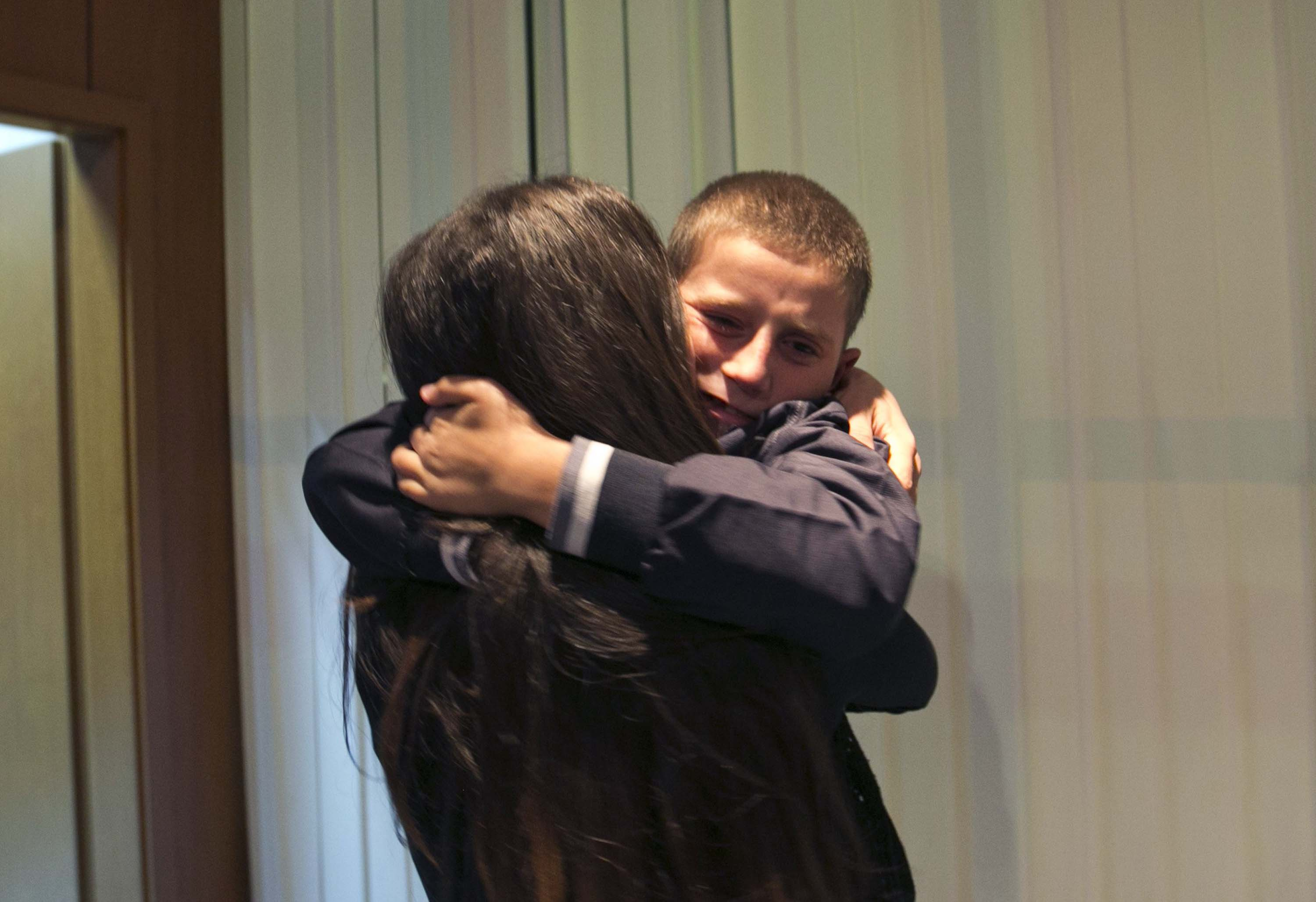 Pranvera Abazi kisses her son Erion Zena during their reunion at Kosovo's main airport upon his return to Kosovo's capital Pristina on Oct. 15, 2014.