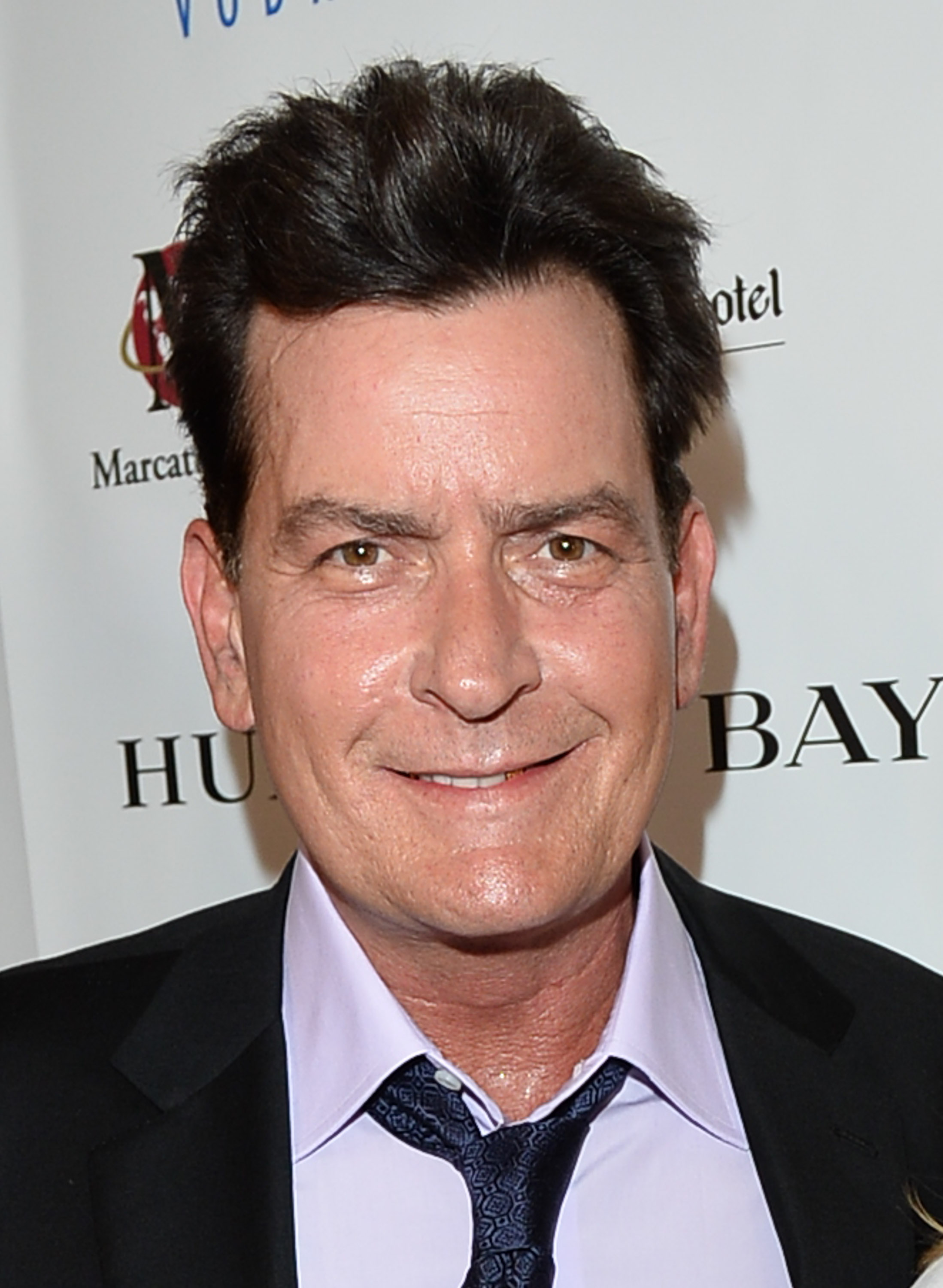Actor Charlie Sheen attends the Joe Carter Classic Charity Golf Tournament after-party at Shangri-La Hotel on June 26, 2014 in Toronto.