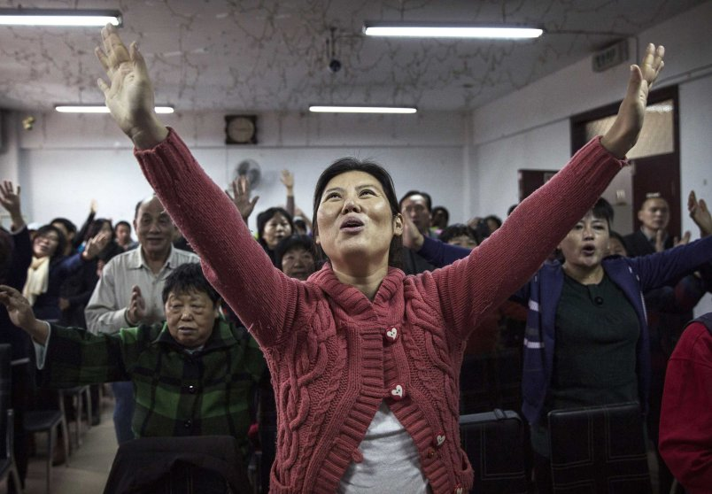 A Christian woman sings during a prayer service.