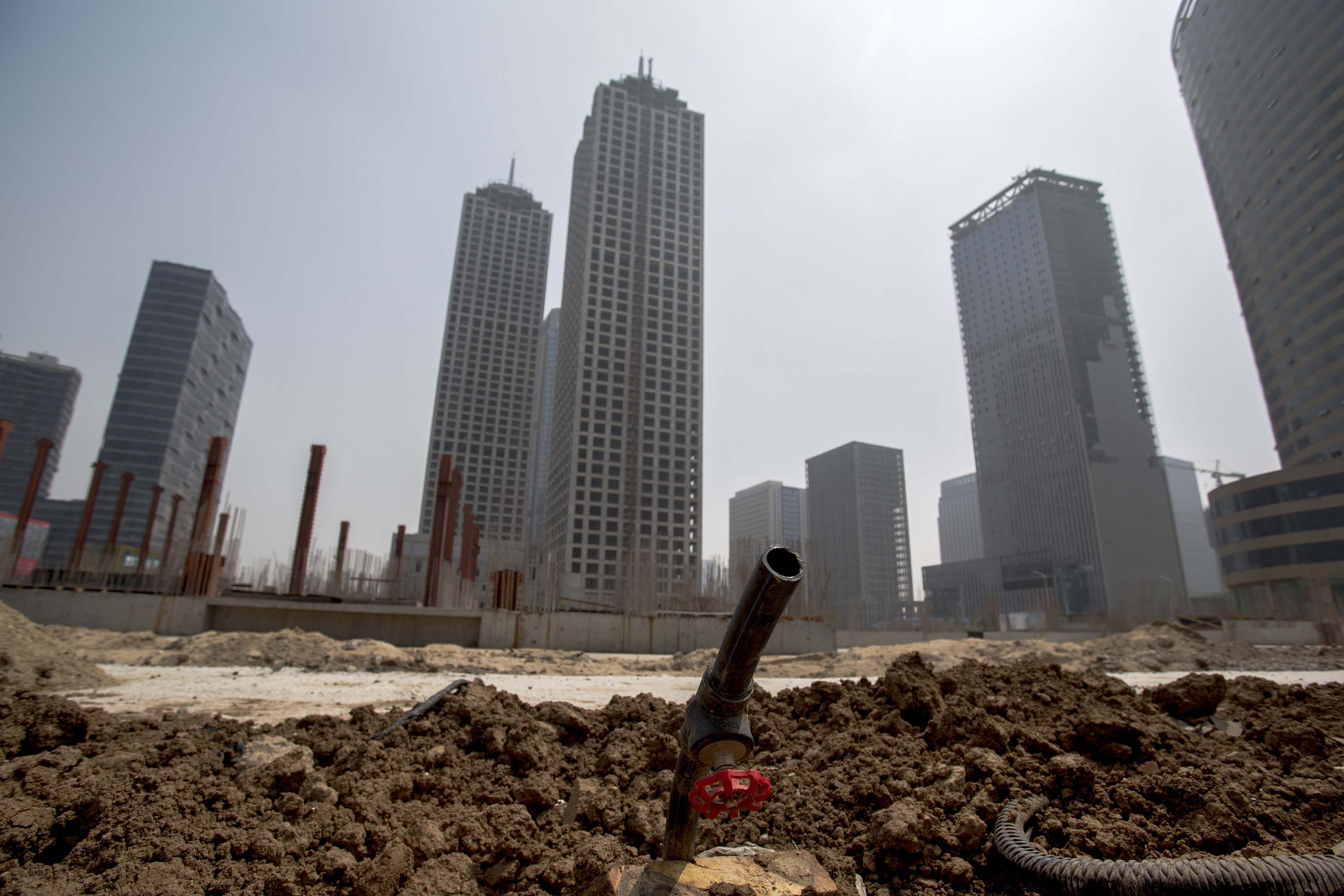 Unfinished buildings are left in the Chinese city of Tianjin, as the slowing property sector takes a toll on the economy