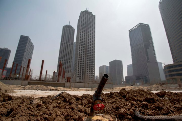 Unfinished buildings and deserted construction site in