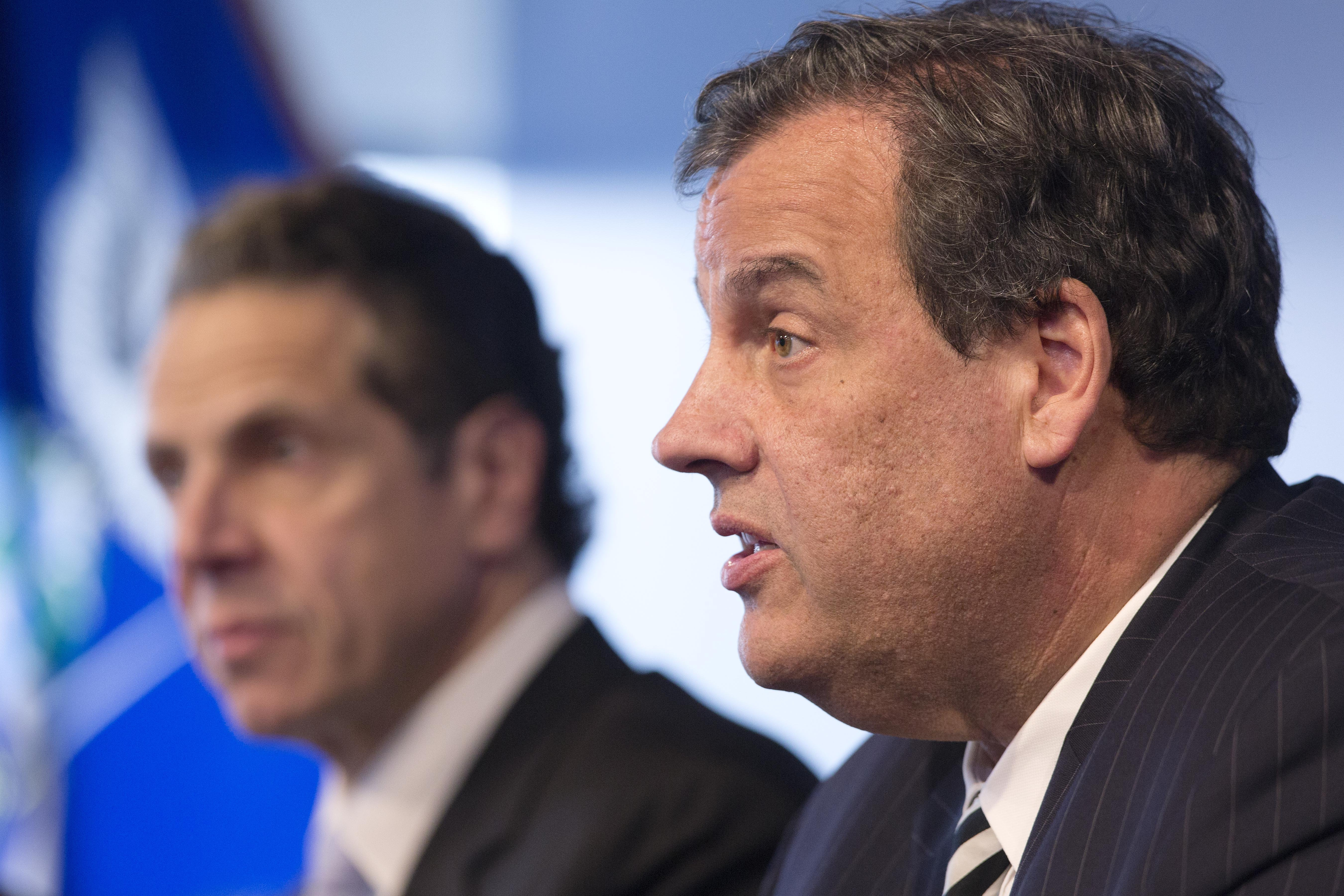 New York Governor Andrew Cuomo listens as New Jersey Governor Chris Christie talks at a news conference ON Oct. 24, 2014 in New York.
