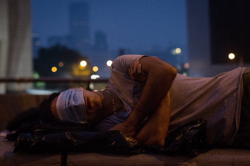 A pro-democracy protester sleeps on a concrete road divider on a street outside the Hong Kong Government Complex on Oct. 5, 2014 in Hong Kong, Hong Kong.