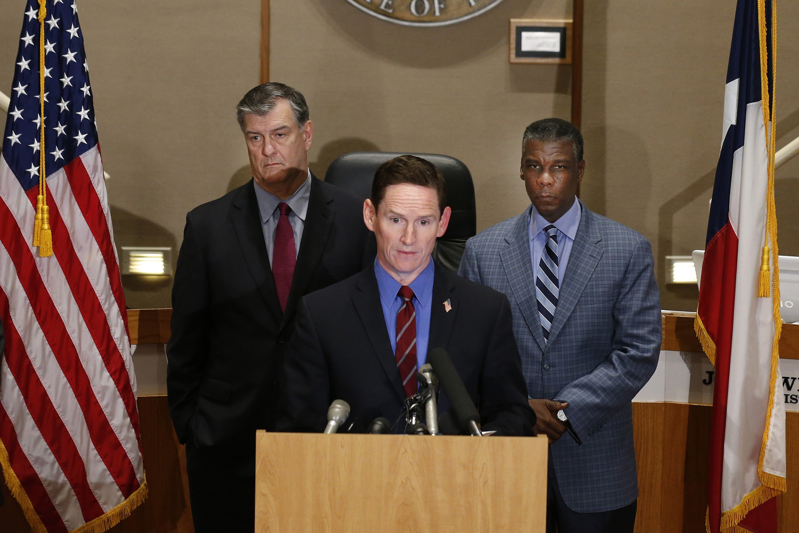 Dr. Daniel Varga, Chief Clinical Officer, Senior Executive Vice President, Dallas Mayor Mike Rawlings, Dallas County Judge Clay Jenkins and Dallas County Human and Health Service Director Zach Thompson held a news conference about the new Ebola case on Oct. 15, 2014 at Dallas County Commissioners Court in Dallas.