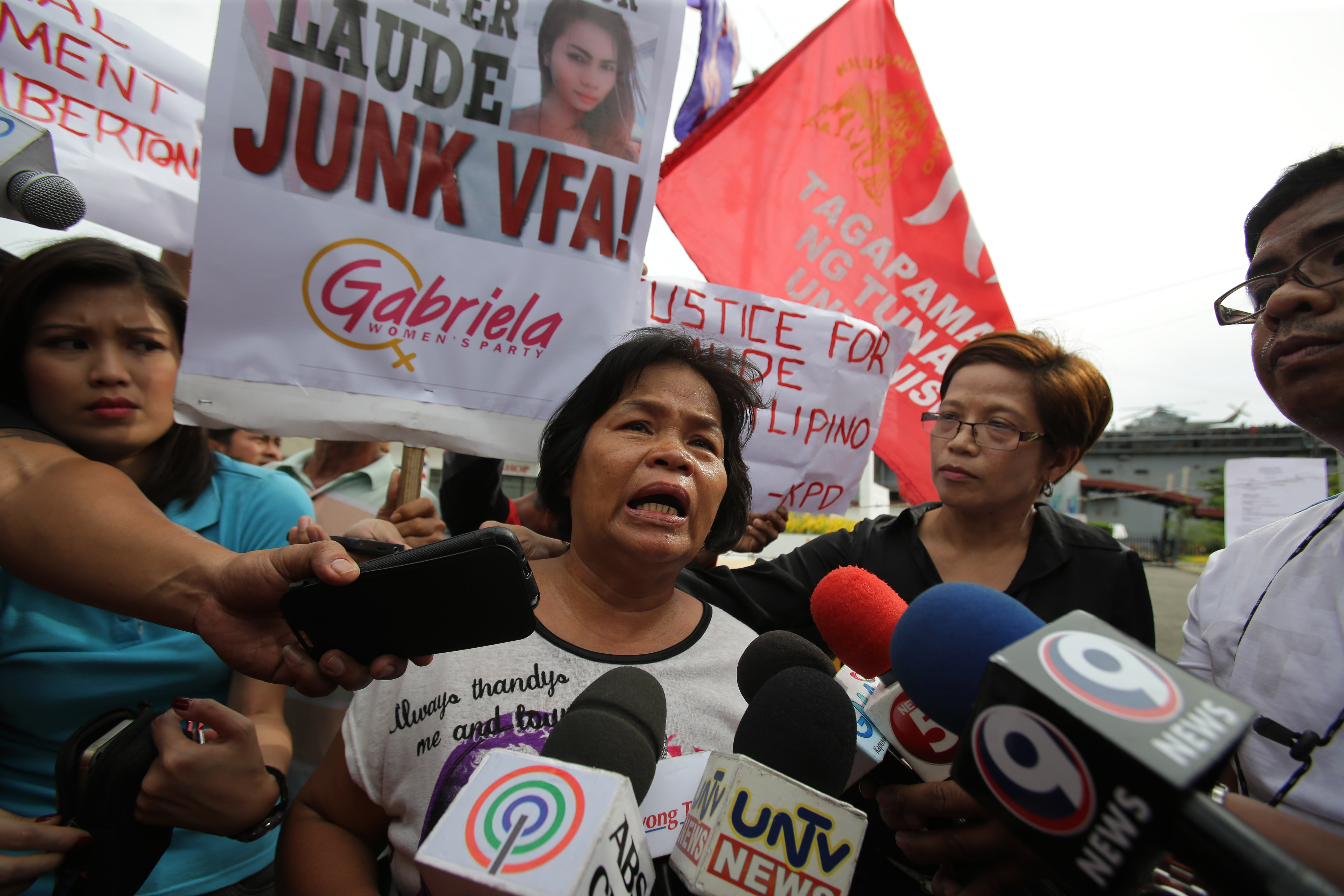 Julita Laude, mother of killed transgender Jennifer Laude, talks to reporters during a rally near the USS Peleliu, where U.S. Marine Pfc. Joseph Scott Pemberton is said to be held, at the Subic Bay free port, Zambales province, northern Philippines. Oct. 18, 2014.