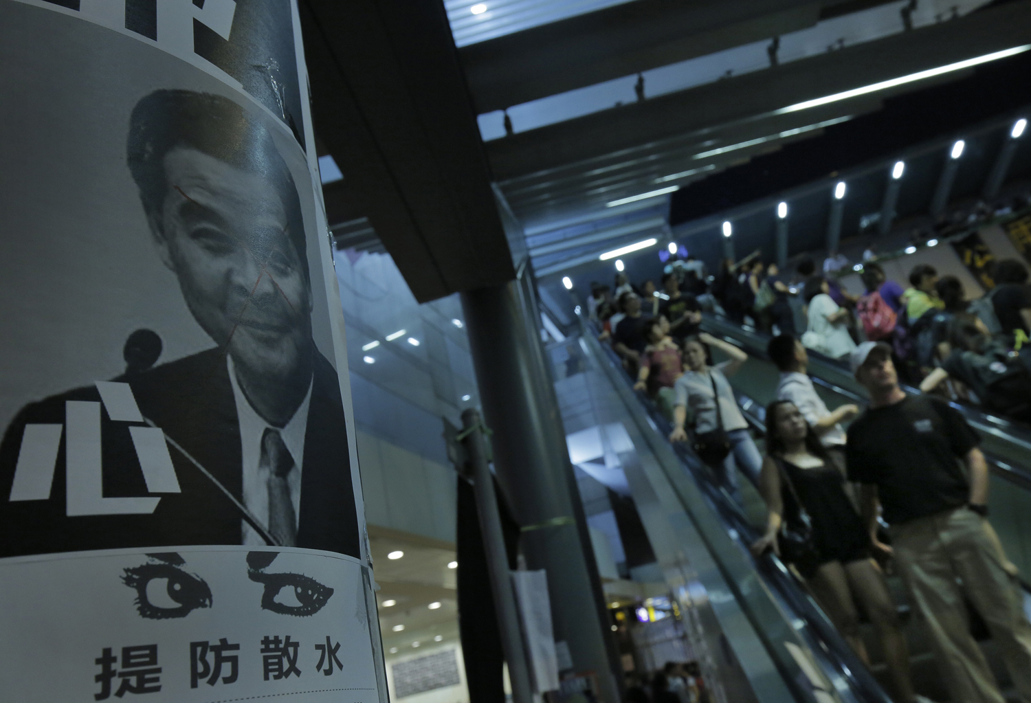 A defaced picture of Chief Executive Leung Chun-ying is seen outside government headquarter in Hong Kong on Oct. 5, 2014.