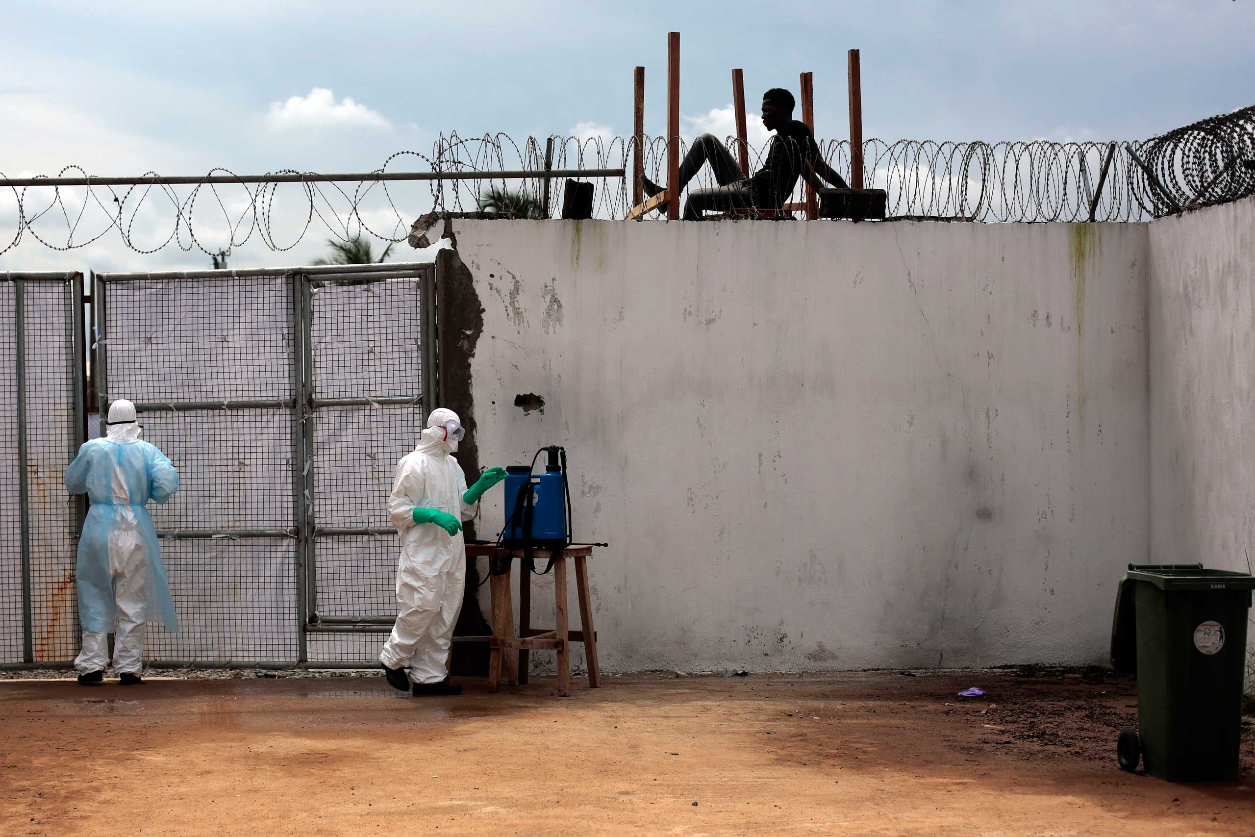 Sept. 26, 2014. Health workers stand outside the Island Clinic Ebola isolation and treatment center in Monrovia, Liberia.