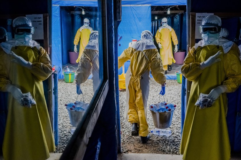 Health workers enter the high-risk zone as they make the morning rounds at the Bong County Ebola Treatment Unit in Sgt. Kollie Town near Gbarnga, Liberia, Oct. 6, 2014.
