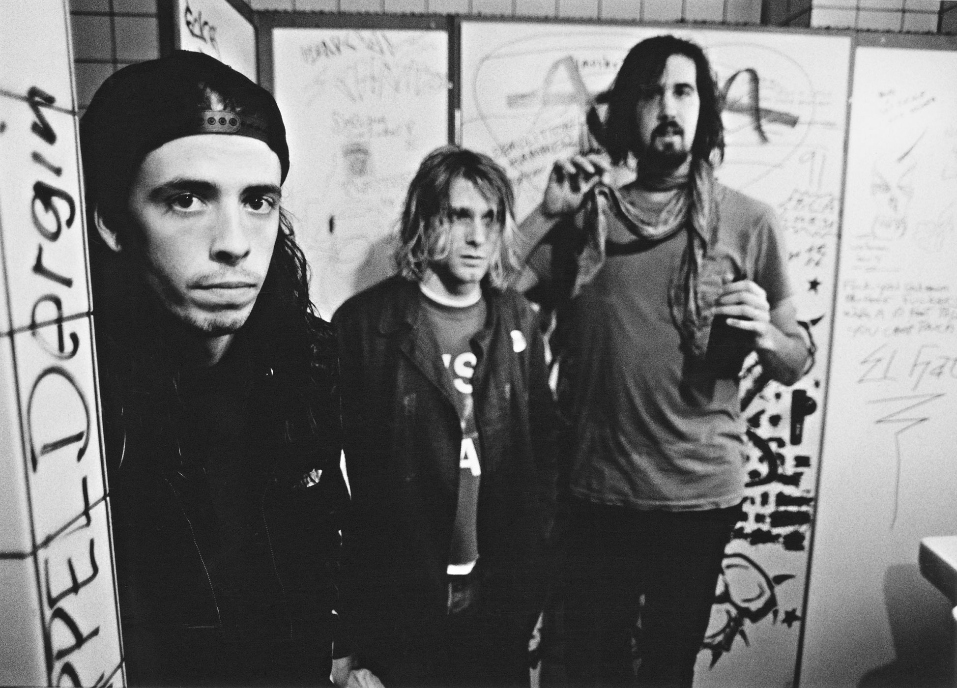 Nirvana backstage in Frankfurt, Germany, on November 12, 1991. From left to right: drummer Dave Grohl, singer and guitarist Kurt Cobain and bassist Krist Novoselic.