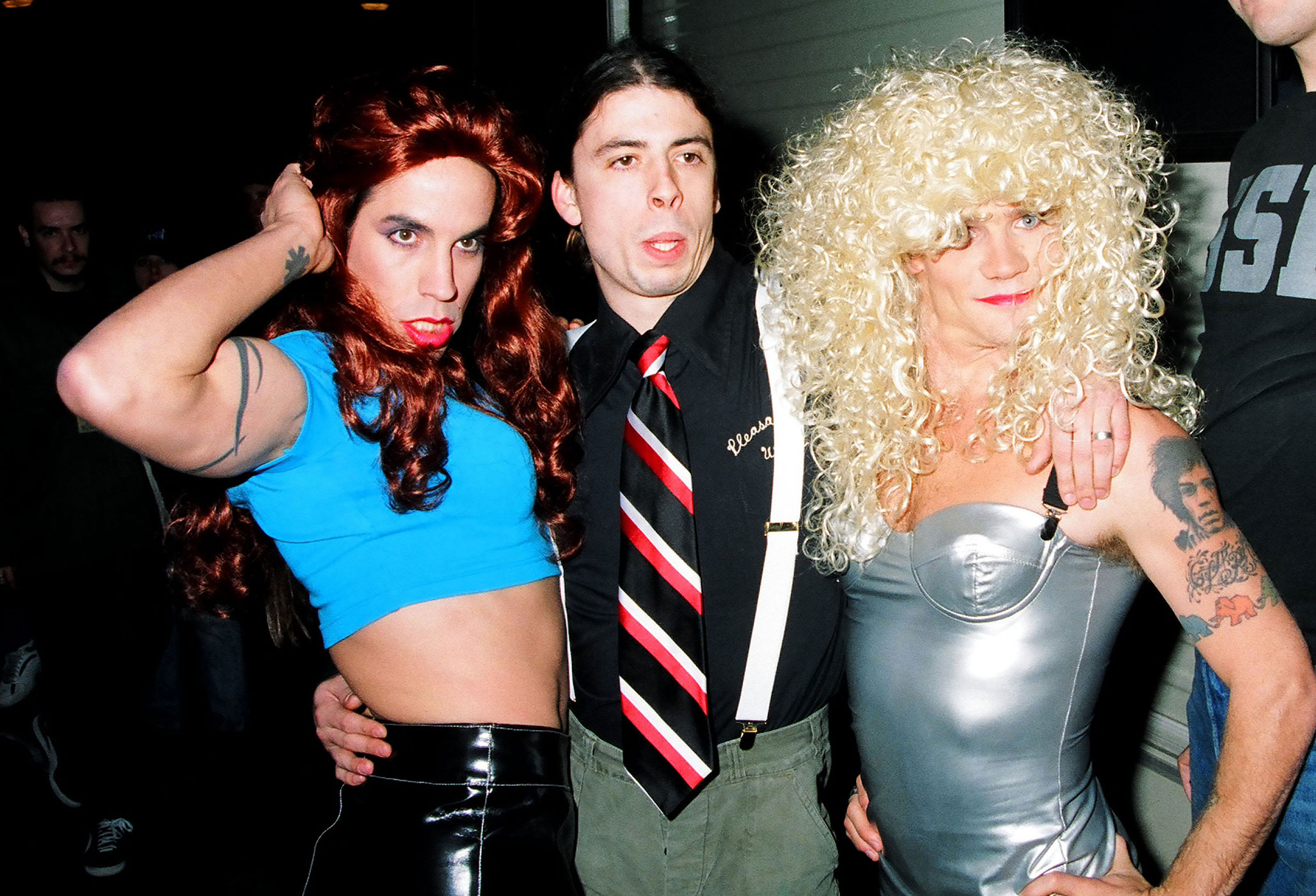 Dave Grohl of Nirvana (center) with Anthony Kiedis and Flea of Red Hot Chili Peppers at MTV Live and Loud in December 1993.