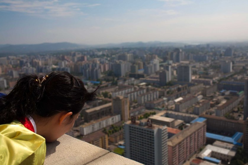Aug. 26, 2011. A North Korean woman looks down at the city of Pyongyang from the top of the Tower of the Juche Idea.