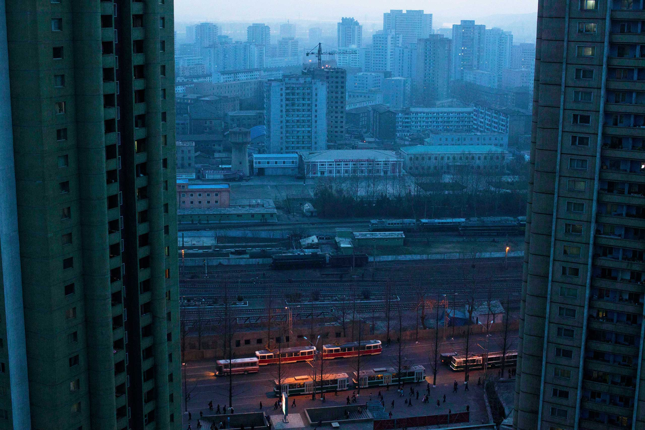 April 12, 2011. Central Pyongyang at dusk through a hotel room window.