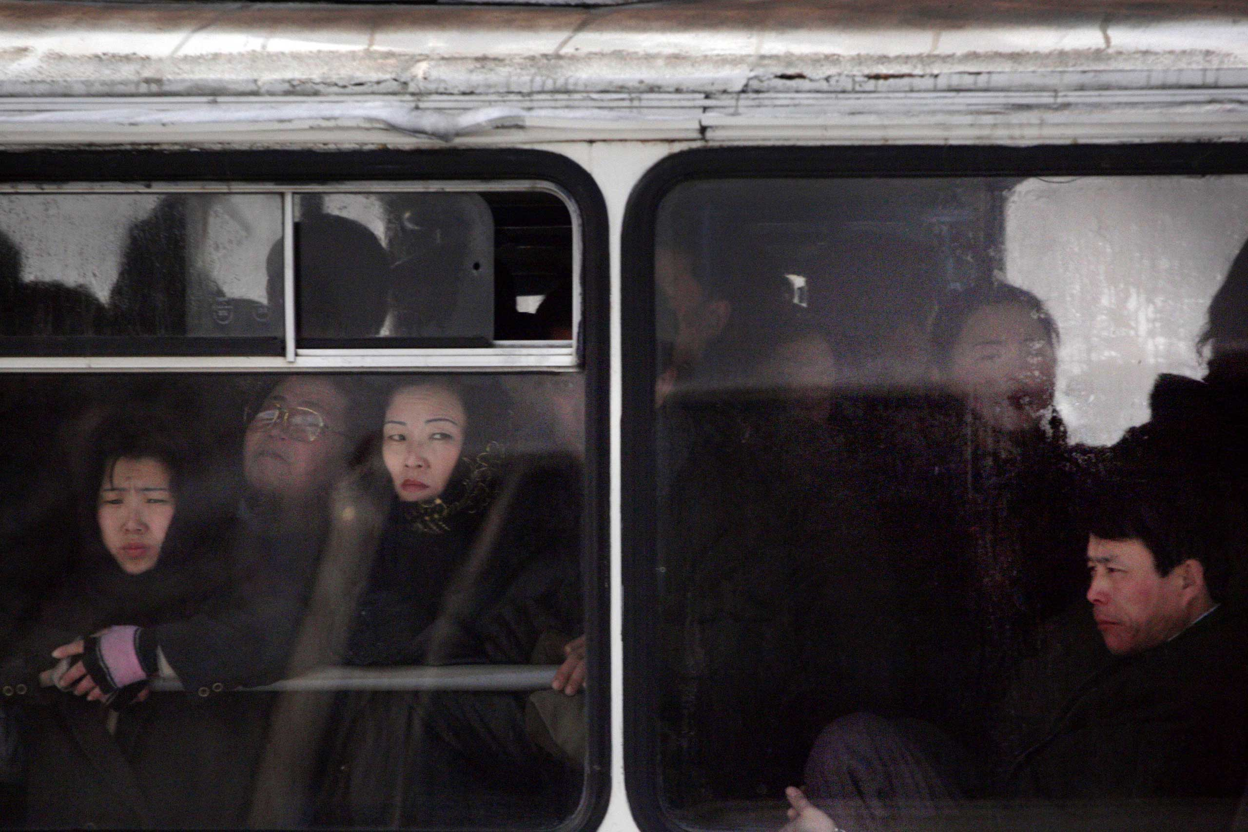 Feb. 26, 2008. North Korean commuters are seen riding a bus in central Pyongyang.