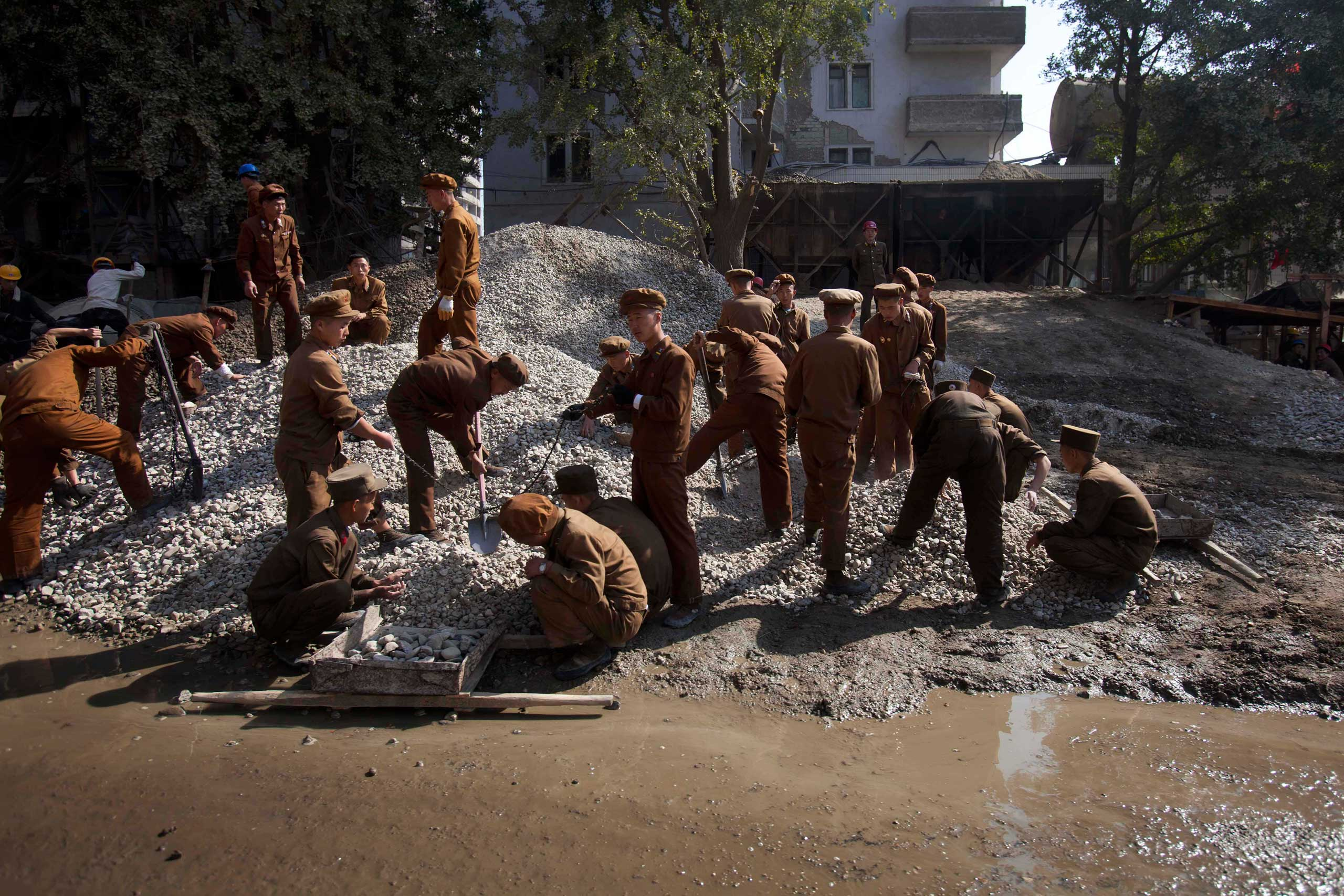 Oct. 11, 2011. North Korean construction workers labor in the Mansudae area of Pyongyang.