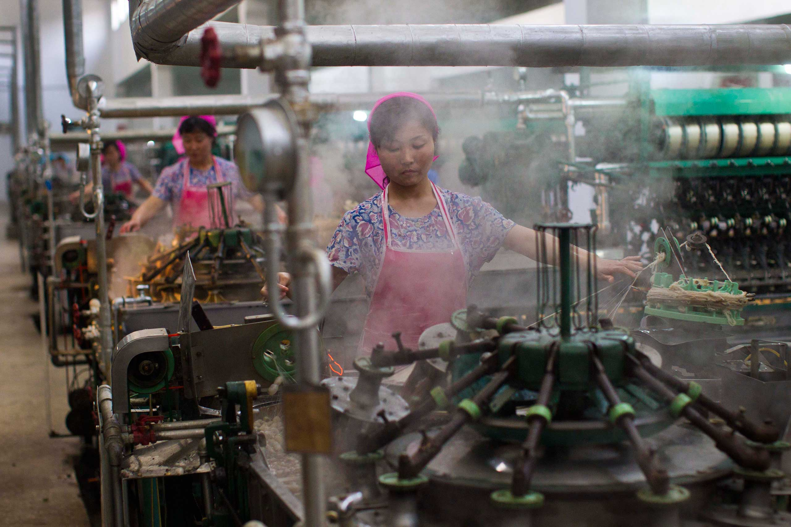 April 9, 2012. North Korean women are pictured working in a thread factory in Pyongyang.