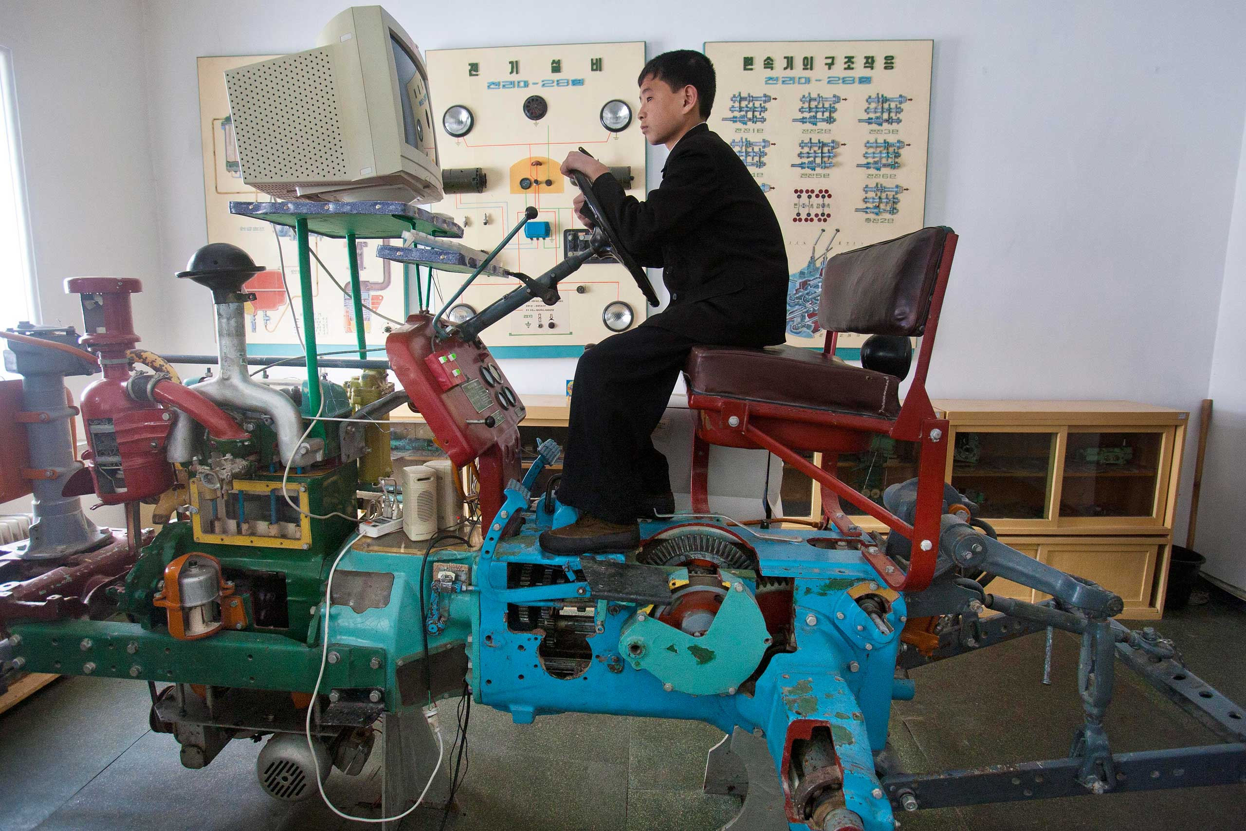 April 3, 2012. A North Korean student learns to drive a tractor on a computerized driving simulator at the Samjiyon Schoolchildren's Palace in Samjiyon, North Korea.