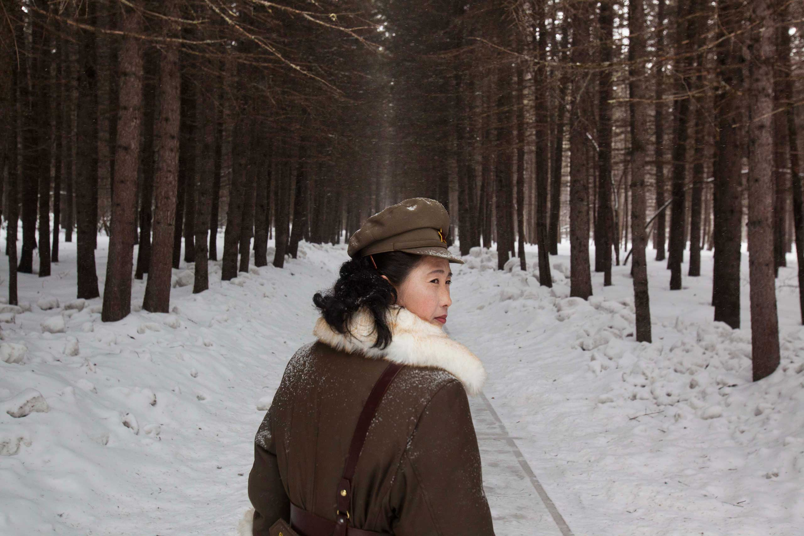April 4, 2012. a North Korean soldier working as a guide walks through a forest at the foot of Mount Paektu, North Korea.