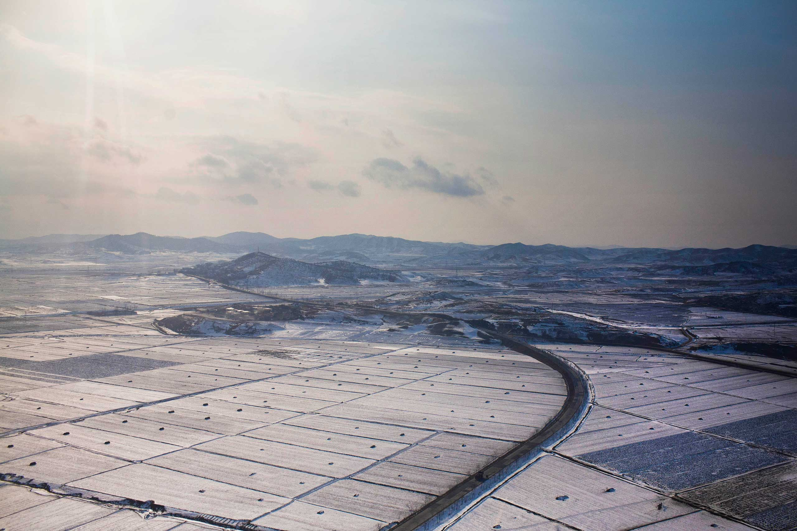 Feb. 11, 2012. Snow blankets farm fields on the outskirts of Pyongyang.