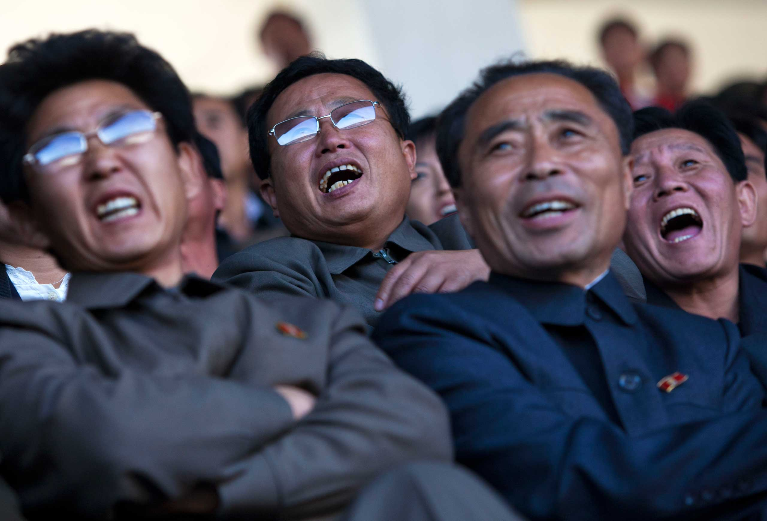 Oct. 11, 2011. North Korean soccer fans react after their team missed a goal during a World Cup qualifying match between North Korea and Uzbekistan, in Pyongyang.