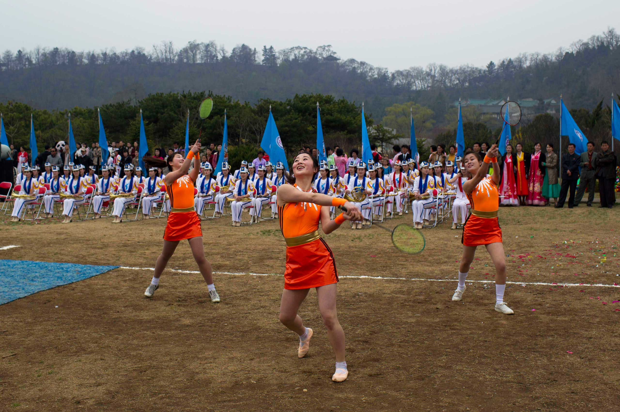 April 15, 2011. Women perform a dance routine with badminton rackets at an event to mark the birthday of Kim Il Sung at a park in Pyongyang, North Korea.