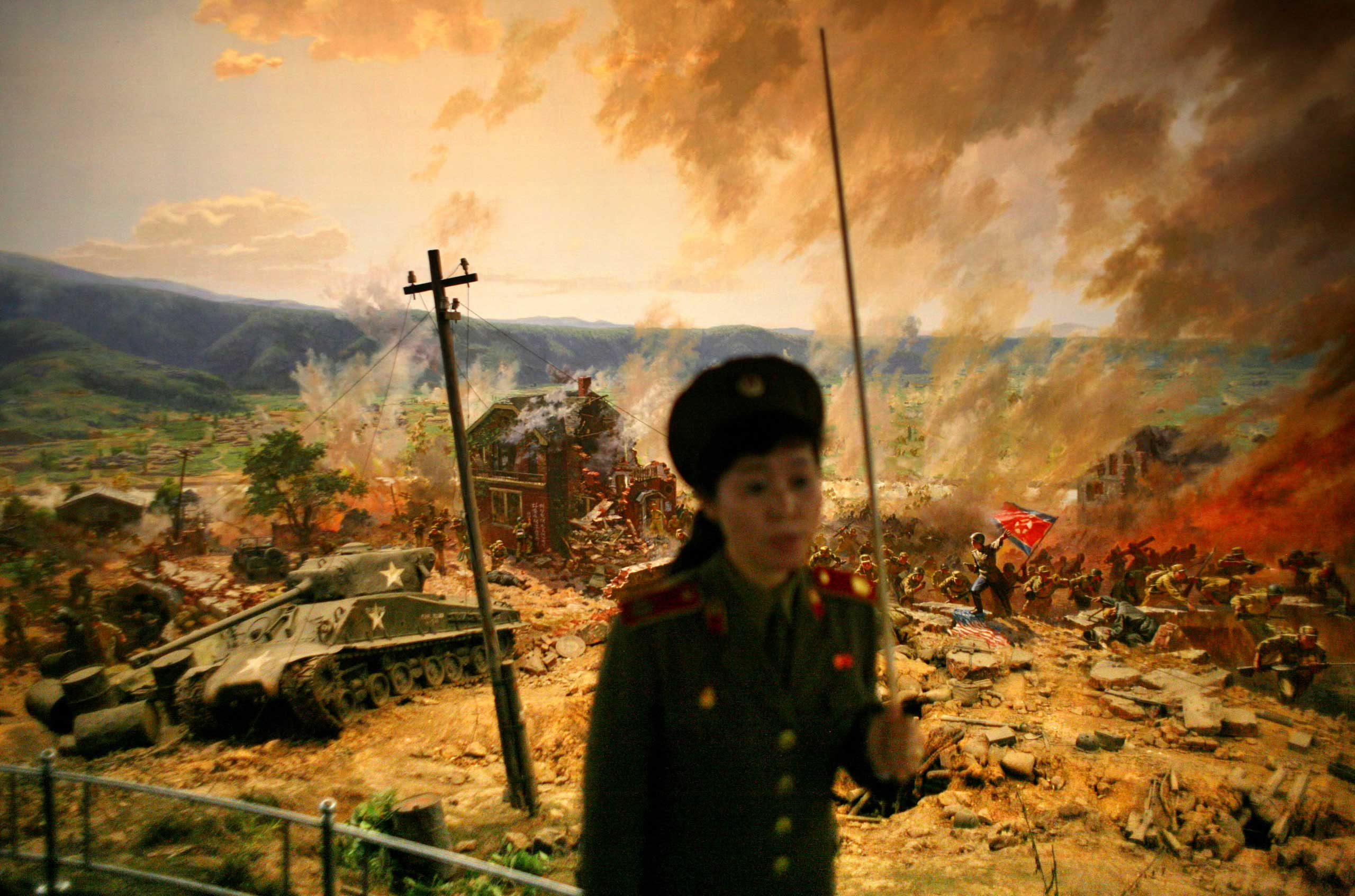 Sept. 16, 2008. A guide gives a lecture in front of a diorama showing the Korean War's 1950 battle of Taejon as she gives a tour of the War Museum in Pyongyang.