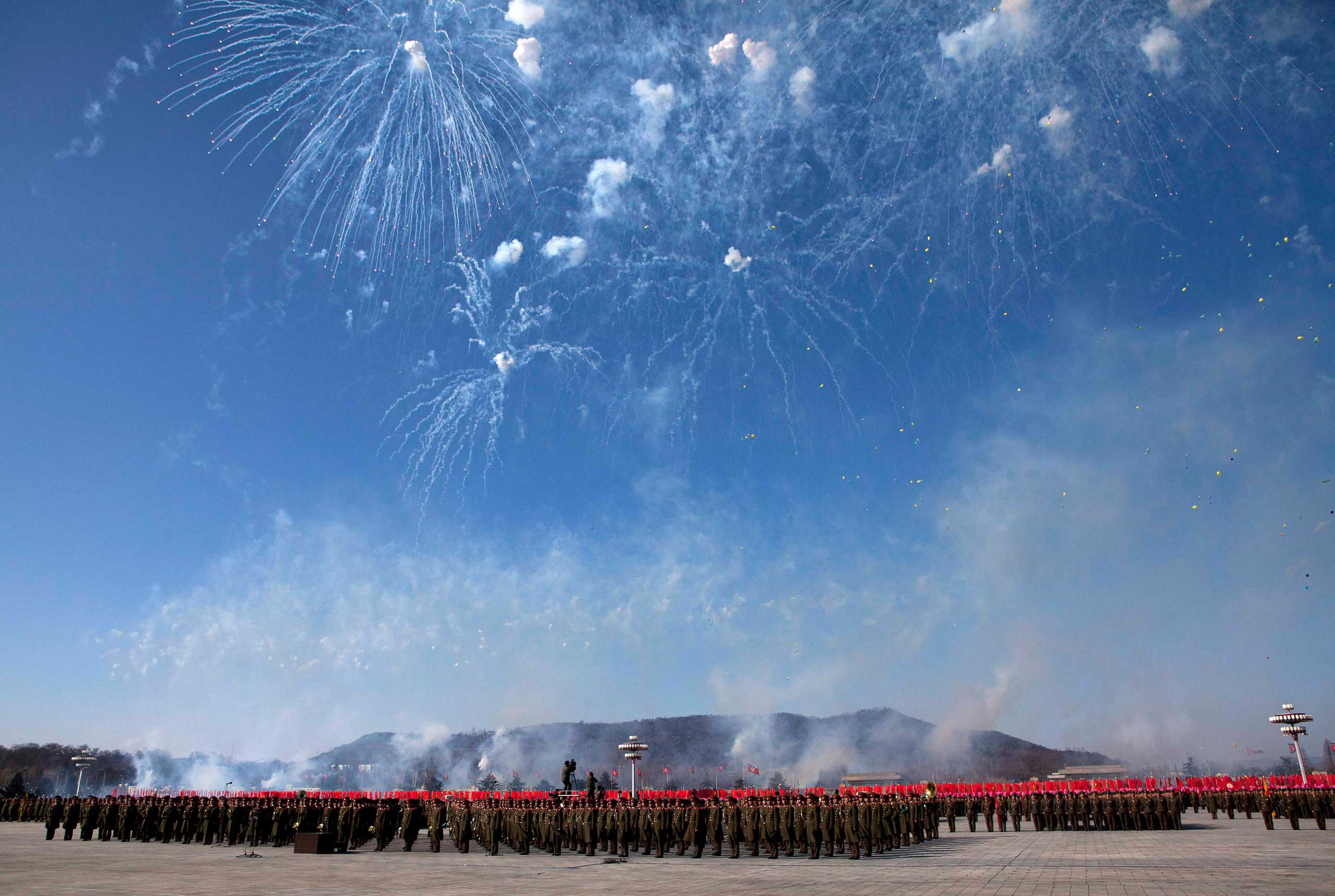 Feb. 16, 2012. Fireworks explode over the heads of North Korean soldiers lined up in formation at Kumsusan Memorial Palace in Pyongyang during a parade of thousands of soldiers commemorating the 70th birthday of the late Kim Jong-Il.
