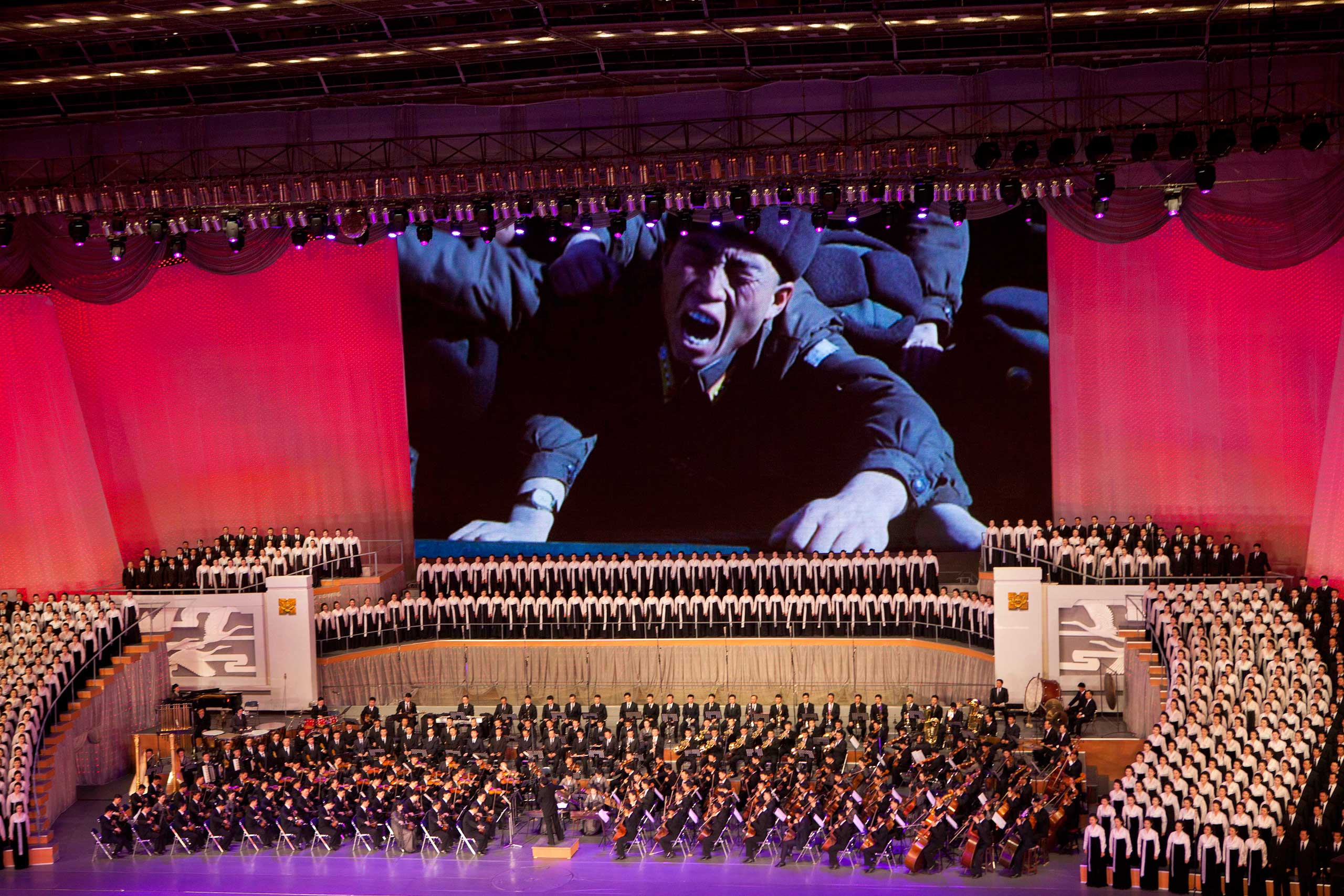 Feb. 16, 2012. A large screen shows video, recorded during the period of mourning following the death of late North Korean leader Kim Jong Il, during a concert in Pyongyang to commemorate his death and what would have been his 70th birthday.