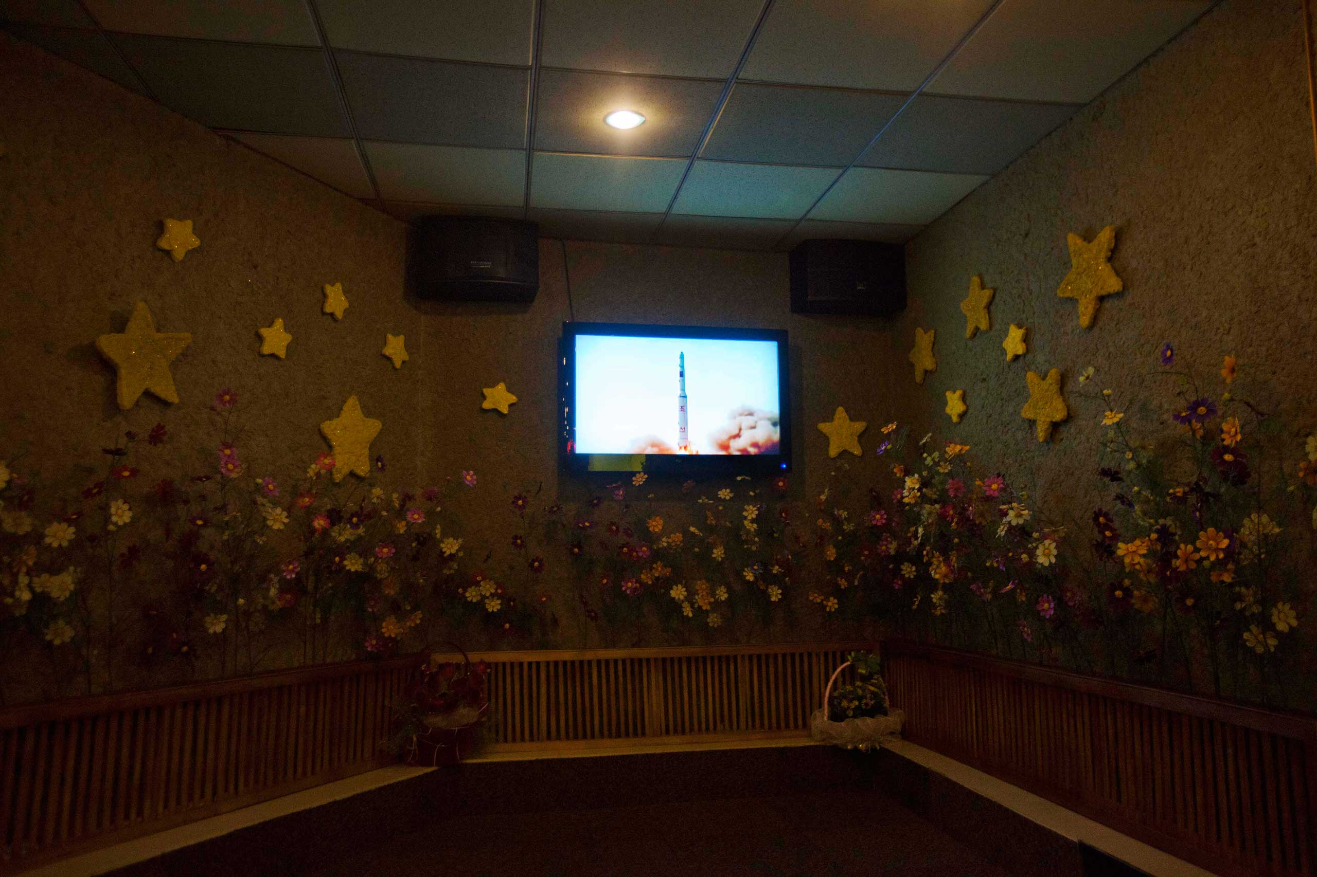 "Jan. 15, 2012. A song and video showing the launch of the North Korean ""Unha-2"" rocket plays on karaoke stage inside a restaurant in Pyongyang."