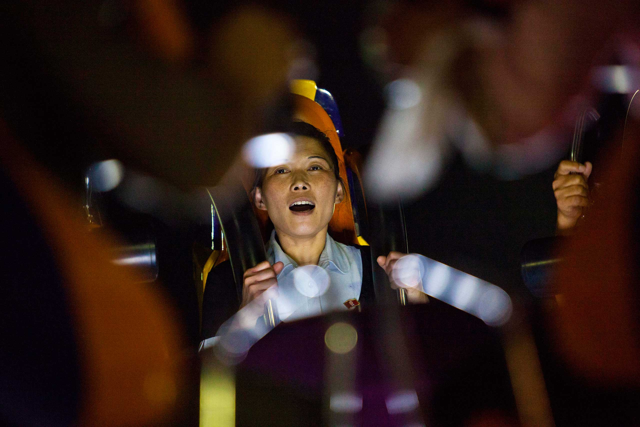 Aug. 8, 2012. A woman rides a roller coaster at a newly-built amusement park in Pyongyang, North Korea.