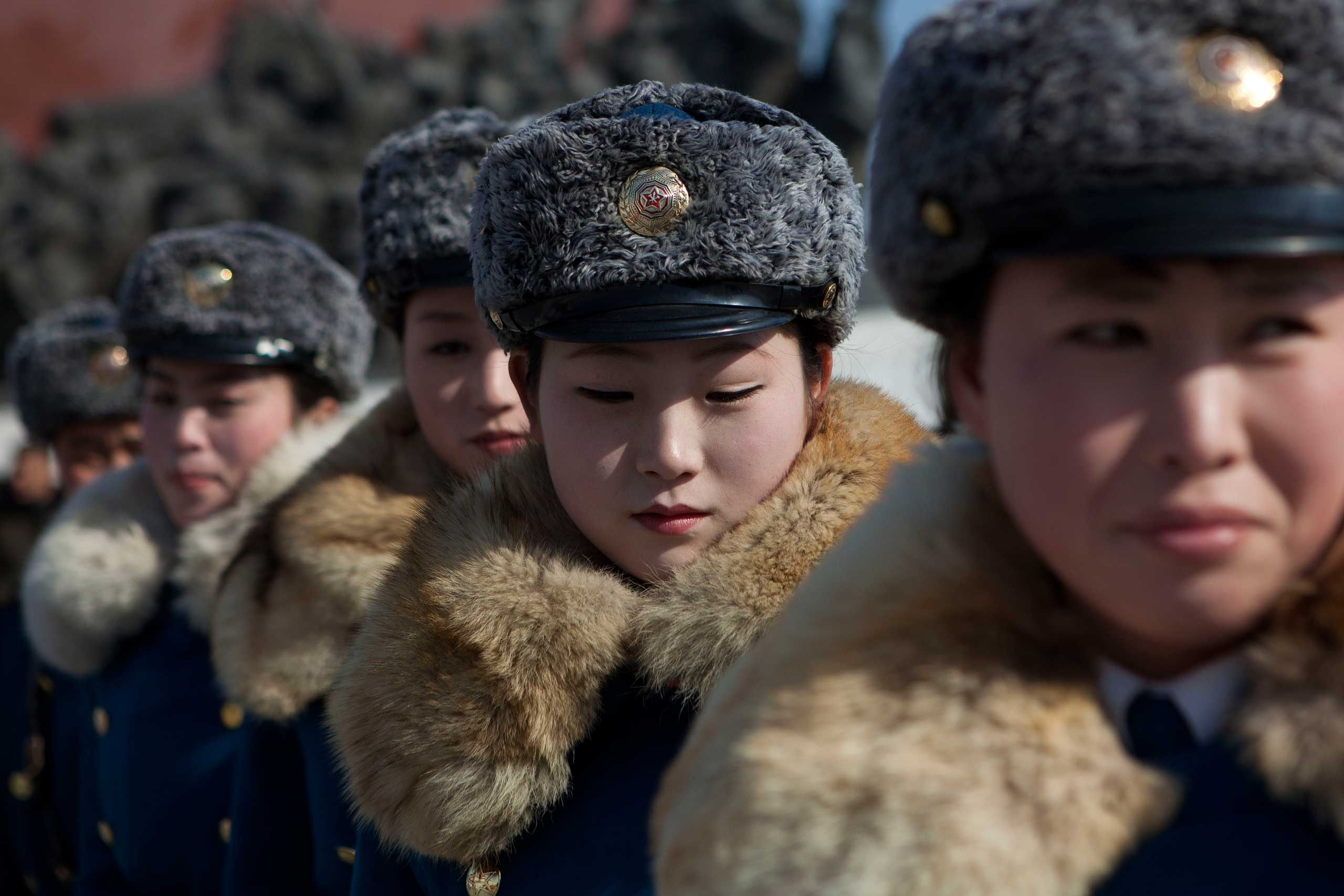 Feb. 16, 2013. Female North Korean traffic police officers gather in front of bronze statues of the late leaders Kim Il Sung and Kim Jong Il to pay their respects in Pyongyang, North Korea.