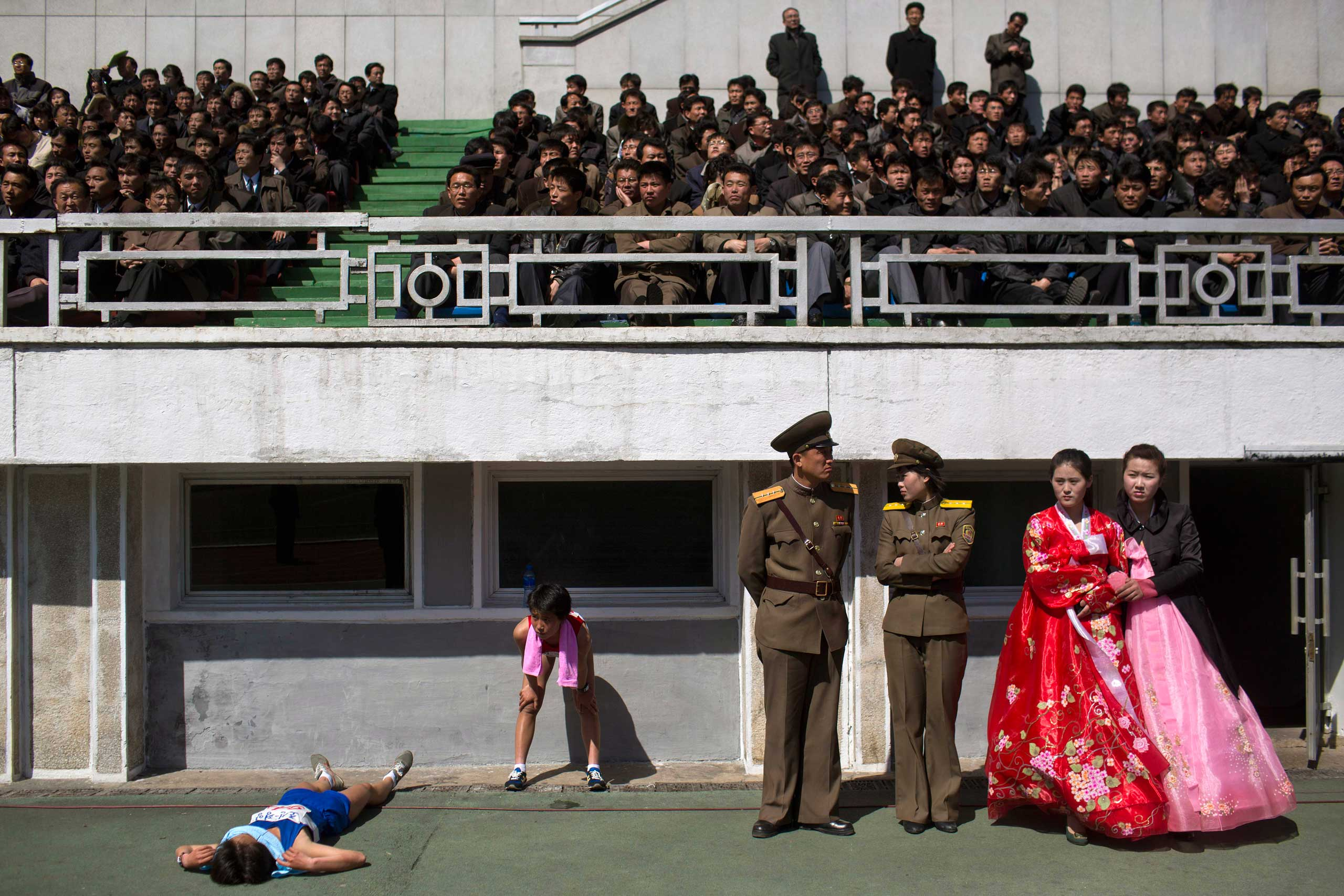 April 14, 2013. Runners rest inside Kim Il Sung Stadium in Pyongyang. North Korea hosted the 26th Mangyongdae Prize Marathon to mark the upcoming birthday of the late leader Kim Il Sung.