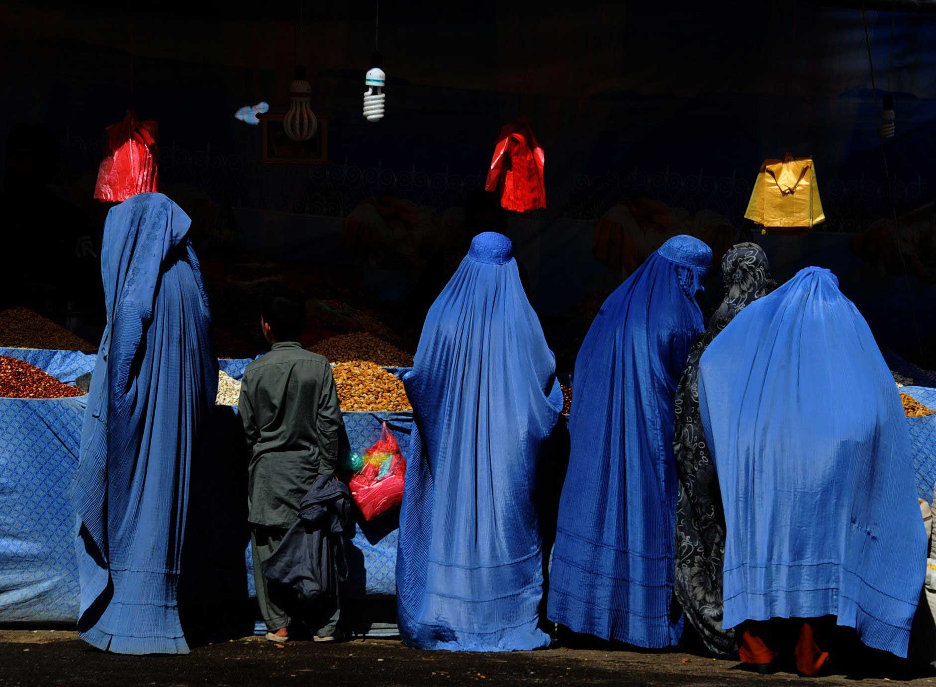 Oct. 1, 2014. Afghan women buy fruit at one of the main markets in Herat. Muslims across the world are preparing to celebrate the annual festival of Eid al-Adha, or the Festival of Sacrifice, which marks the end of the Hajj pilgrimage to Mecca and commemorates Prophet Abraham's readiness to sacrifice his son to show obedience to God.