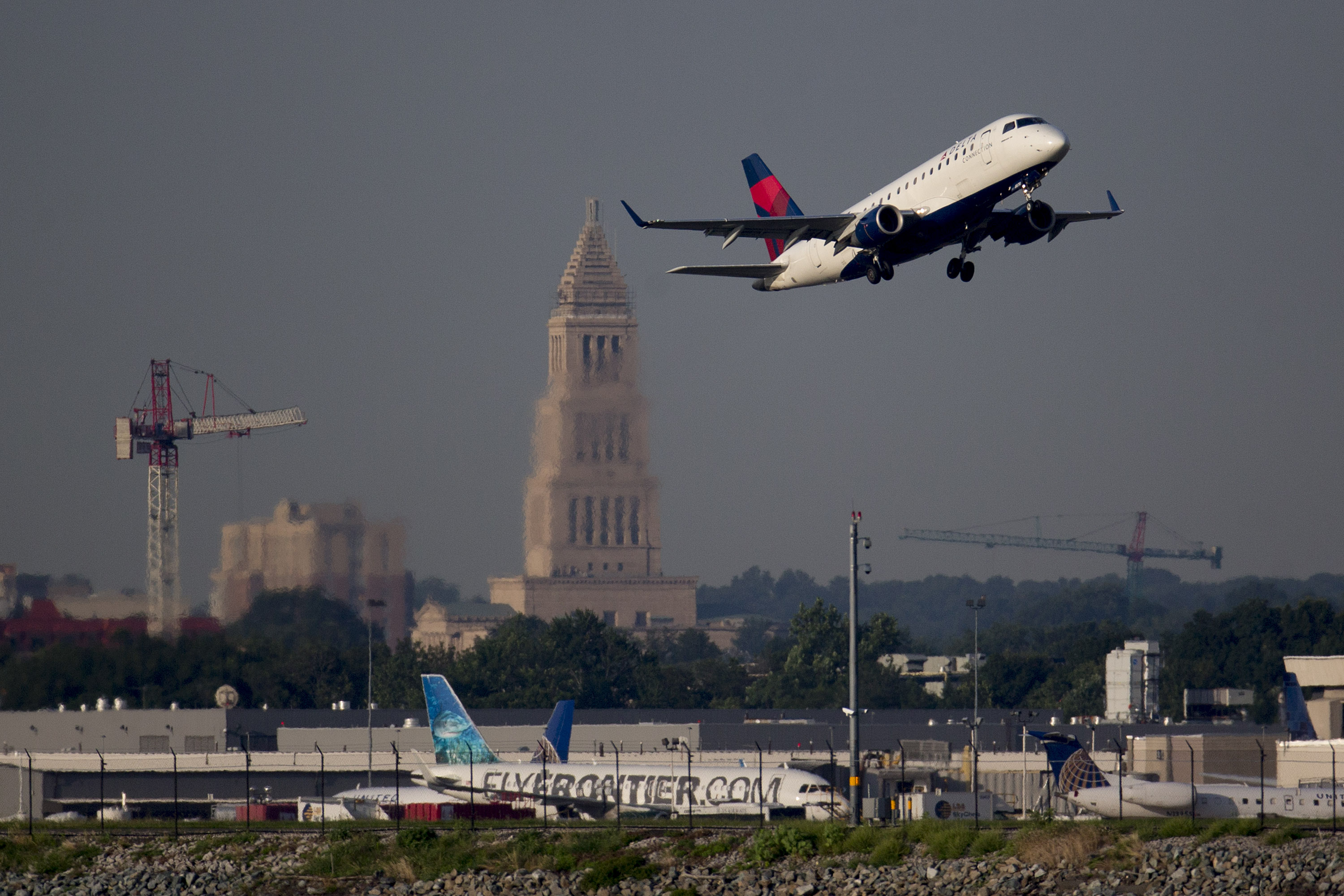 A Delta Air Lines Inc. airplane departs Ronald Reagan National Airport in Washington, D.C., U.S., on Friday, July 18, 2014.