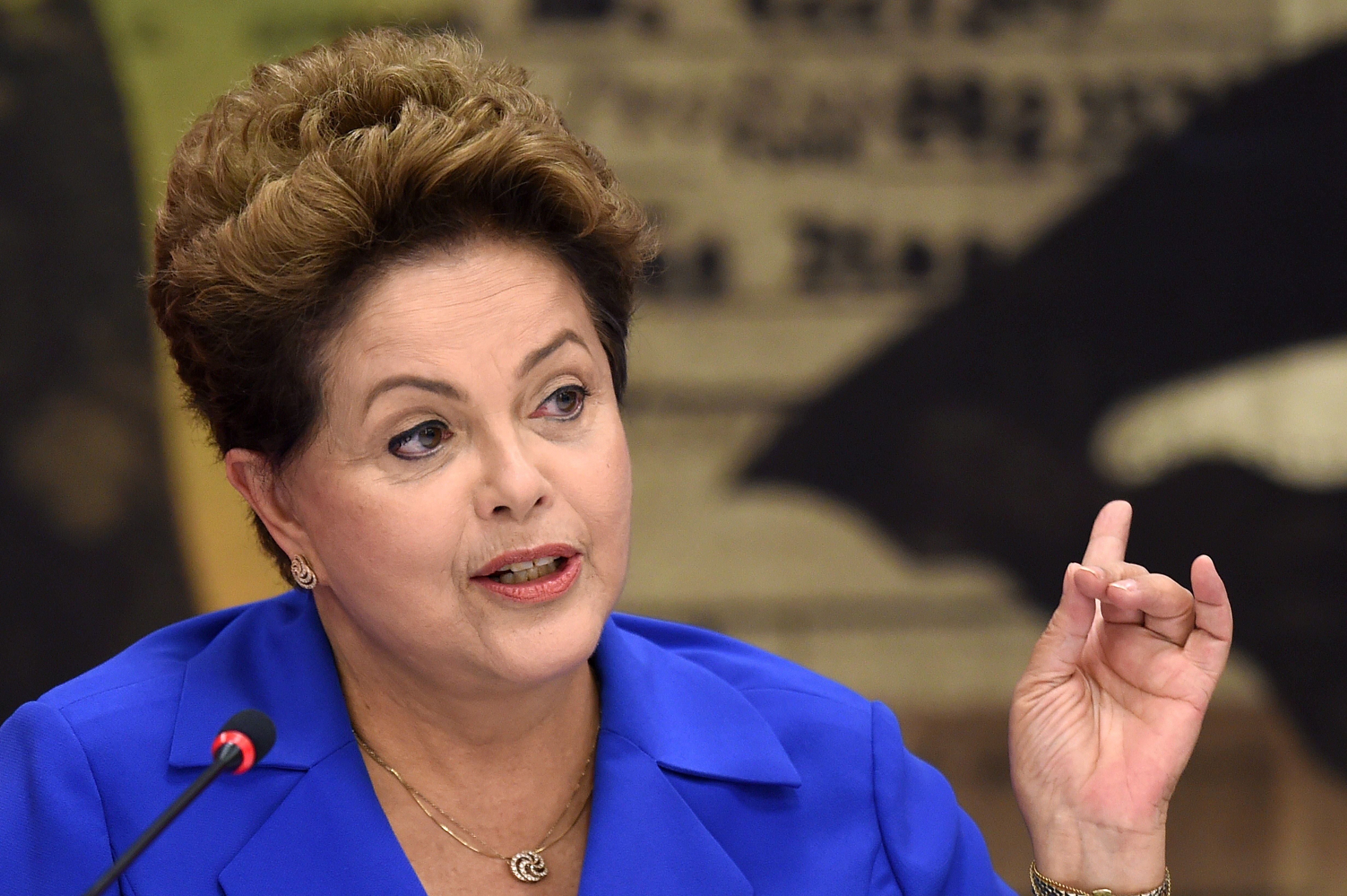 Brazil's President and presidential candidate for the Workers' Party Dilma Rousseff, speaks during a meeting with Governors and Senators elected in the first round of general elections, in Brasilia, Brazil on Oct. 7, 2014.