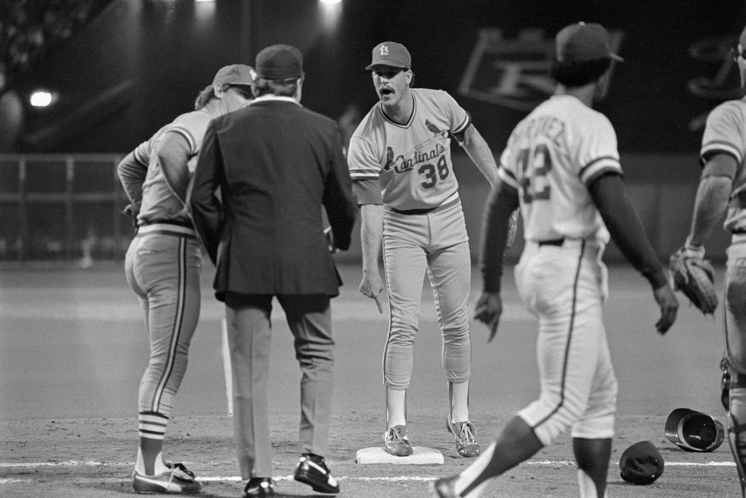 St. Louis pitcher Todd Worrell (facing) argues with first base umpire Don Denkinger in the 9th inning of Game 6 of the 1985 World Series in Kansas City, Missouri.