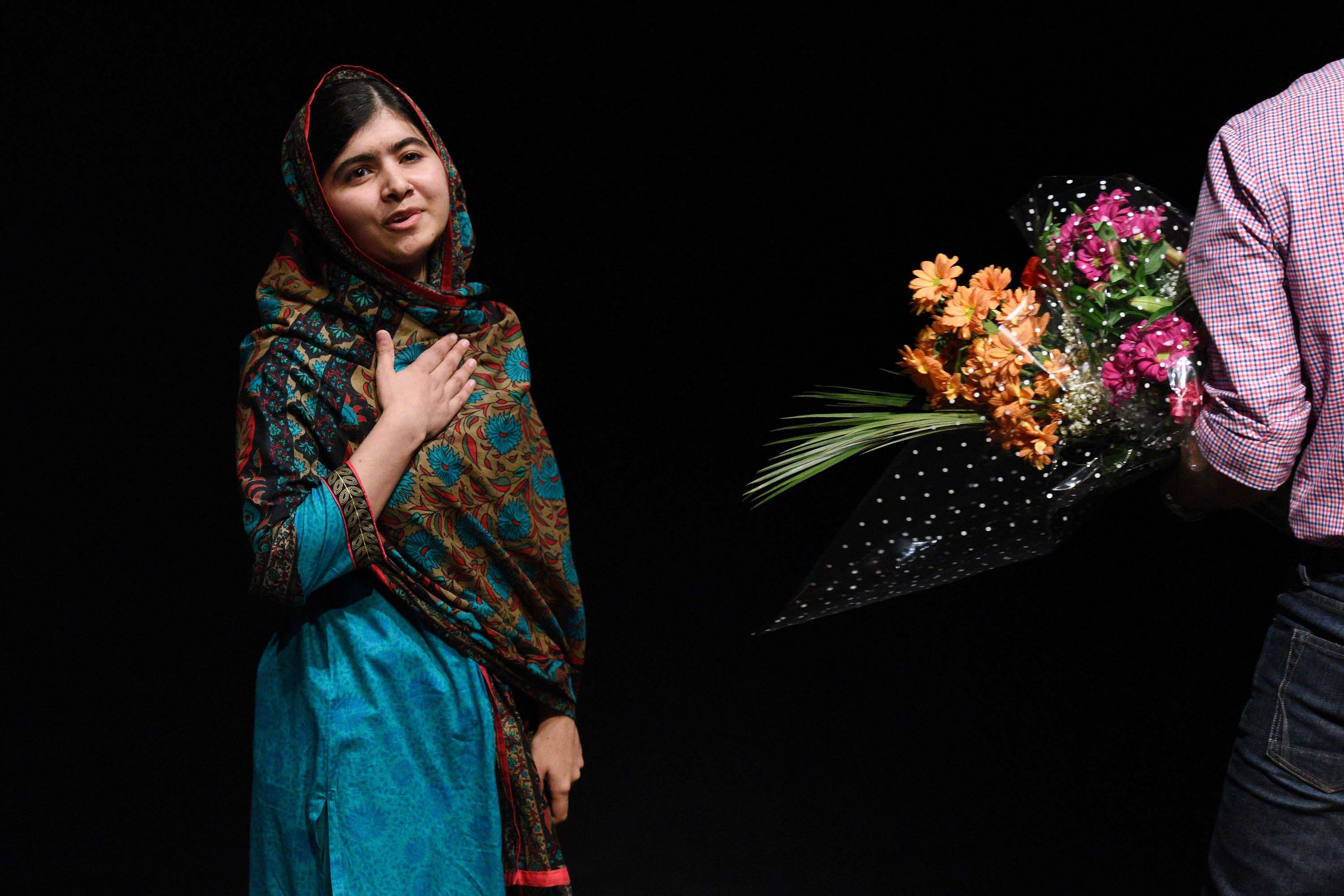The Nobel Peace Prize went to 17-year-old Pakistani Malala Yousafzai and India's Kailash Satyarthi for their work promoting children's rights.  Yousafzai gestures after addressing the media in Birmingham, central England on Oct. 10, 2014.