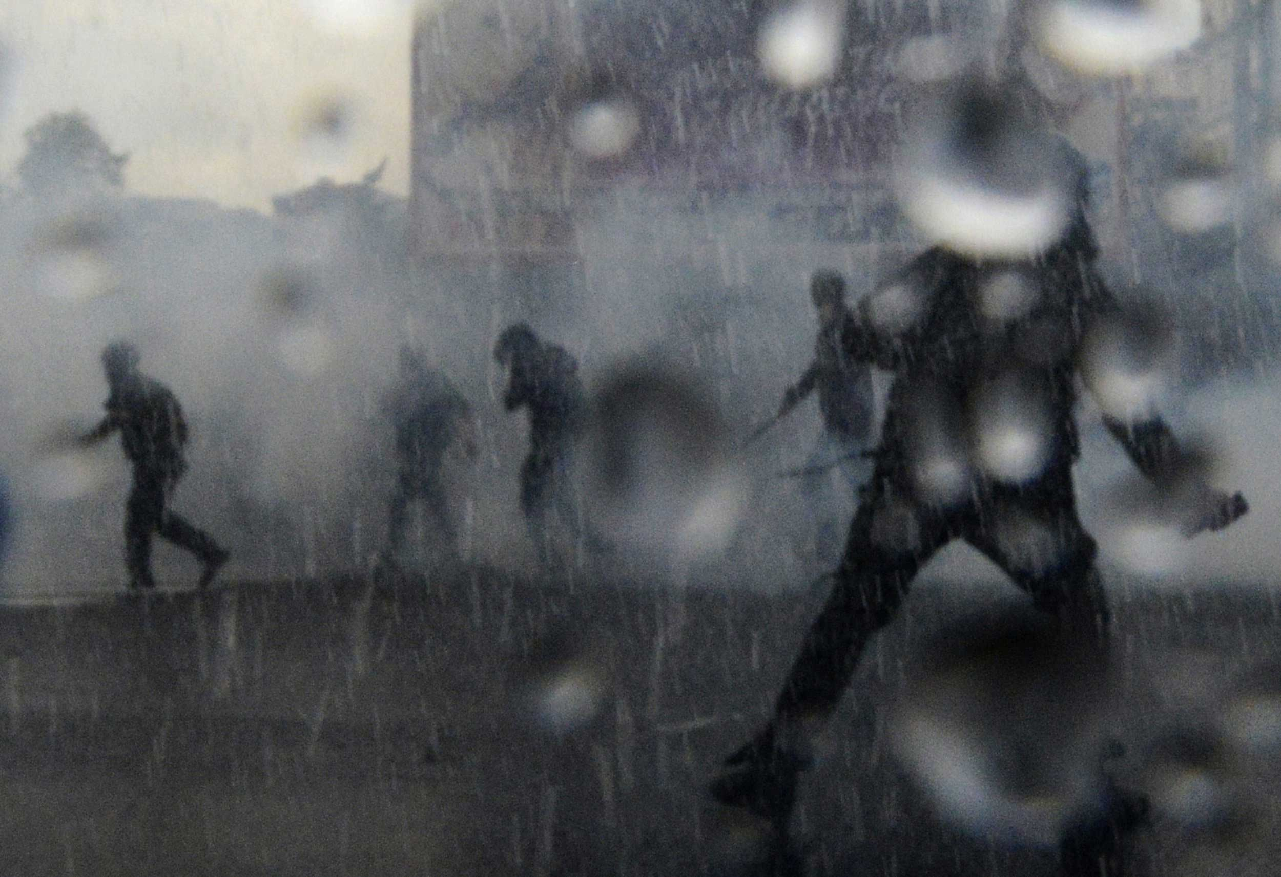 Oct. 2, 2014. Demonstrators confront police with water cannons as the ECB governing council meets in Naples, Italy. European Central Bank head Mario Draghi was expected to underline the bank's willingness to deploy more economic stimulus measures, a stance that could send the euro skidding even lower.