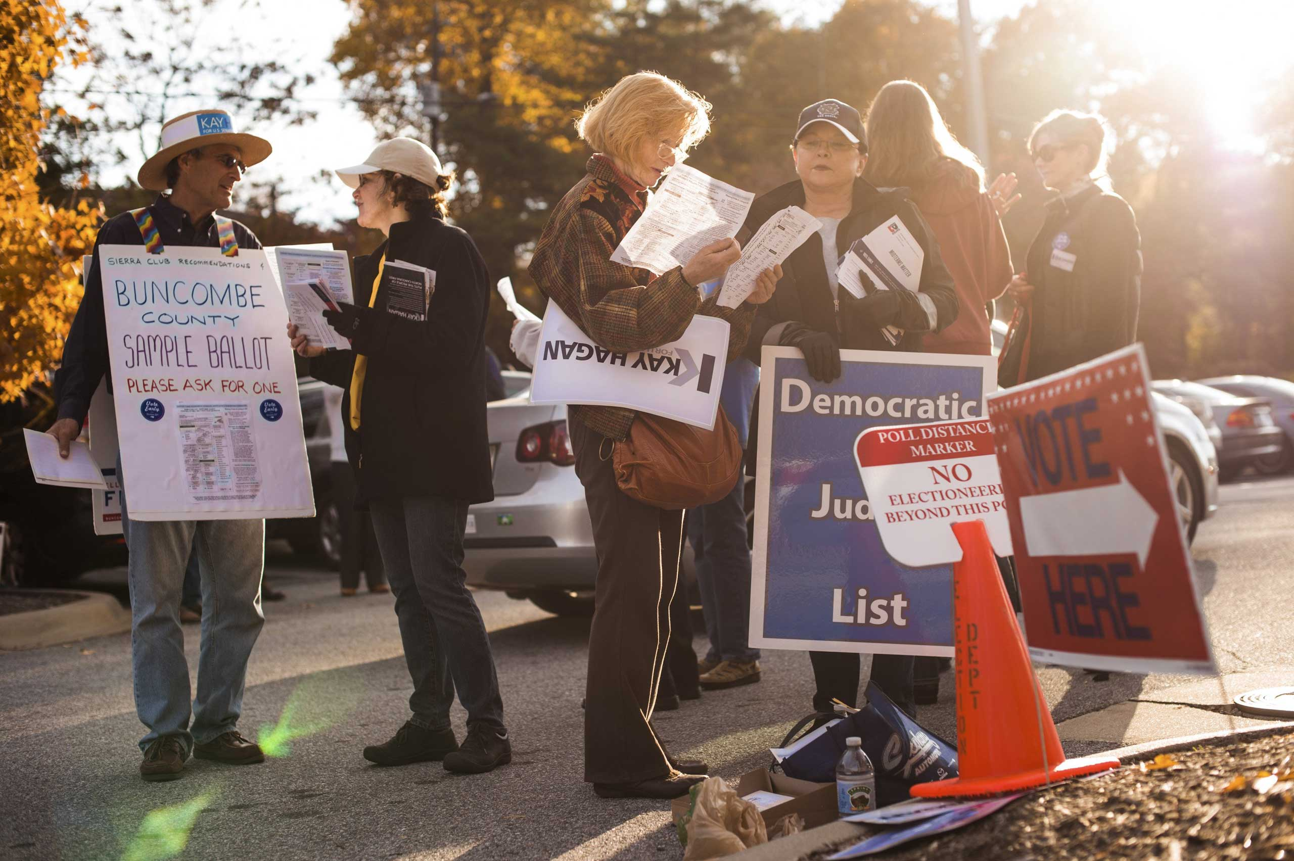Supporters of Sen. Kay Hagan (D-N.C.) outside of a polling place in Asheville, N.C., Oct. 28, 2014.