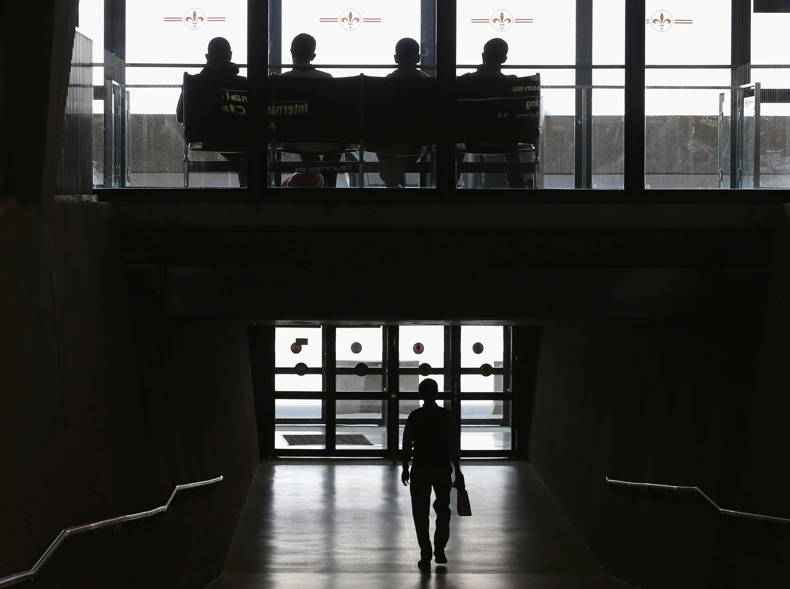 People gather in the terminal at Washington Dulles International Airport in Dulles, Va., on Oct. 2, 2014