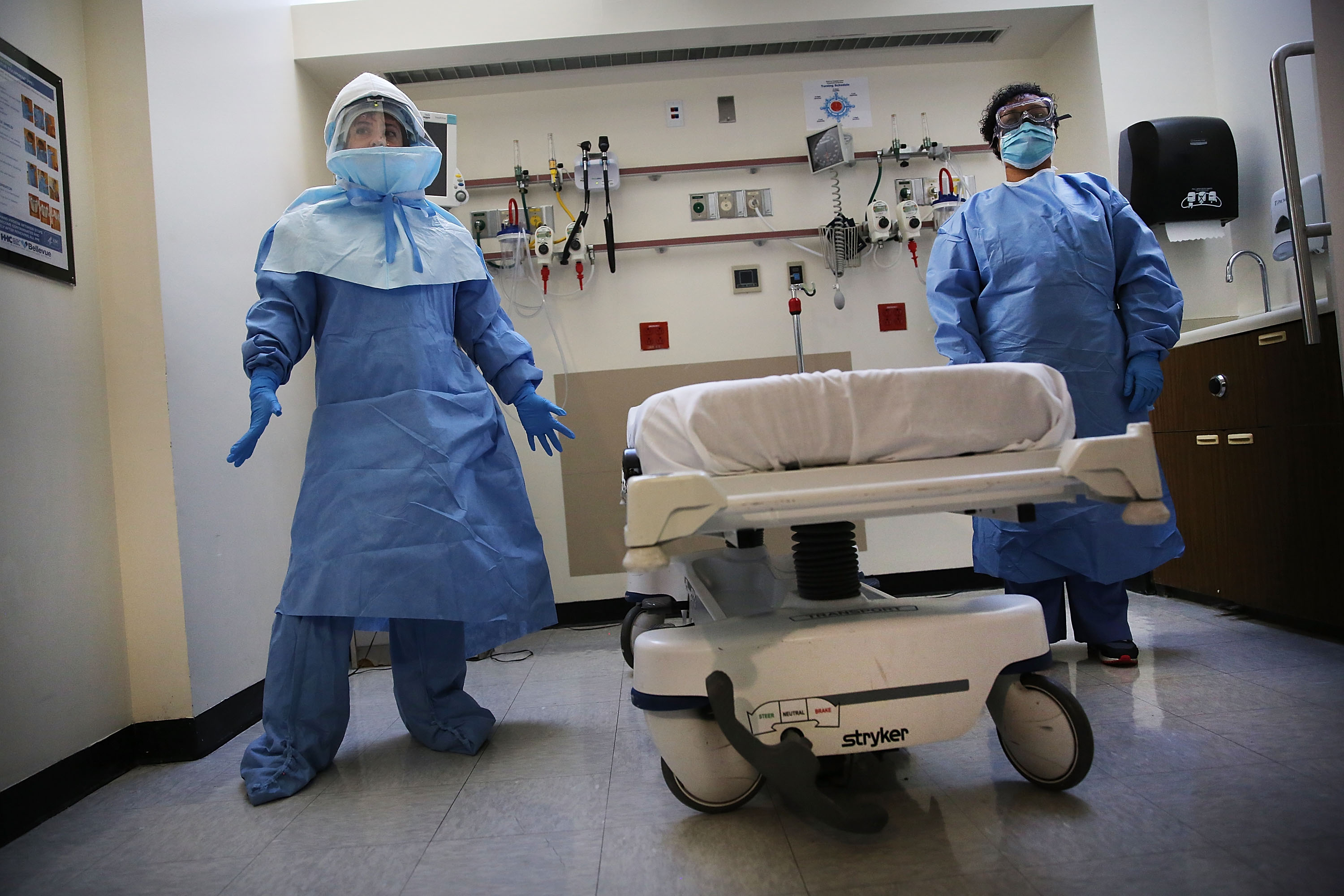 Members of Bellevue Hospital staff wear protective clothing as they demonstrate how they would receive a suspected Ebola patient on Oct. 8, 2014 in New York City.