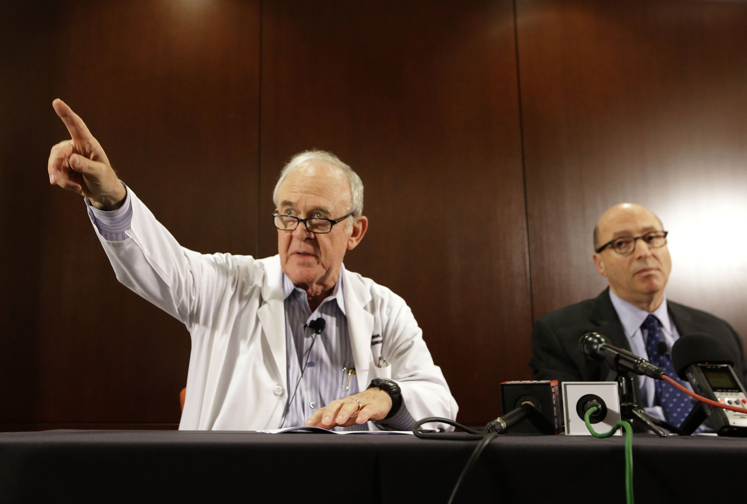 Dr. Edward Goodman, left, epidemiologist at Texas Health Presbyterian Hospital Dallas, points to a reporter for a question as Dr. Mark Lester looks on during a news conference about an Ebola infected patient they are caring for in Dallas, Sept. 30, 2014.