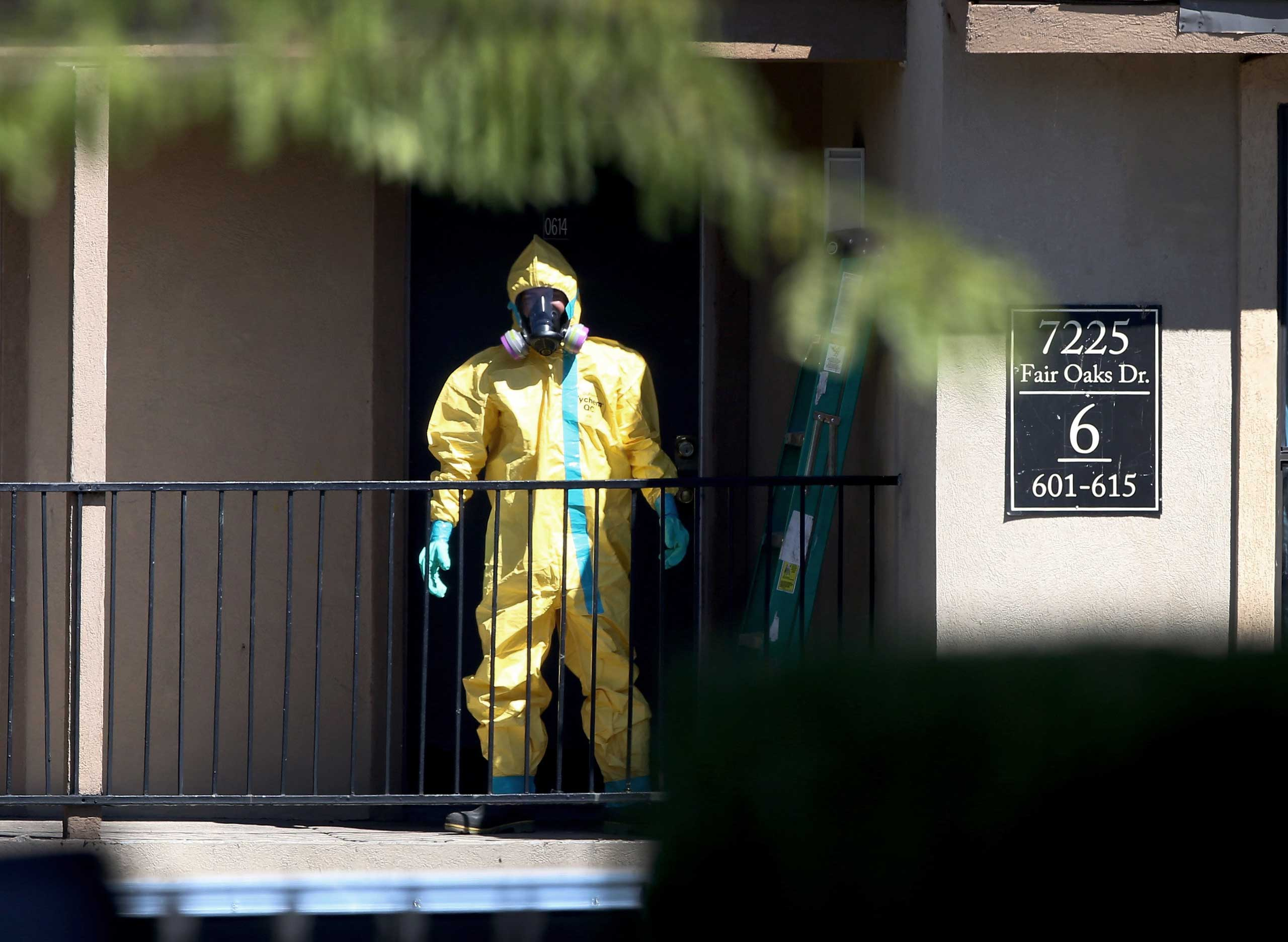 A hazmat team member arrives to clean a unit at the Ivy Apartments, where the confirmed Ebola virus patient was staying, on Oct. 3, 2014 in Dallas, Texas.